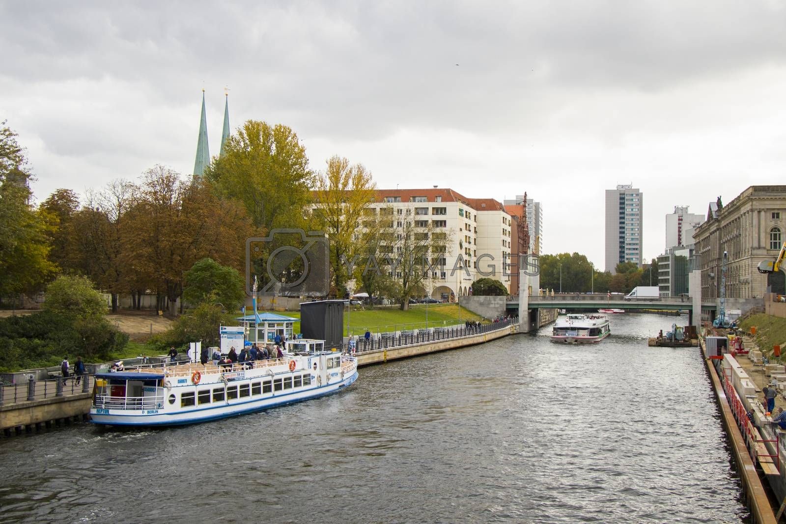 Boats in Berlin river, touristic trip with boats, white big boats in the city center in Germany