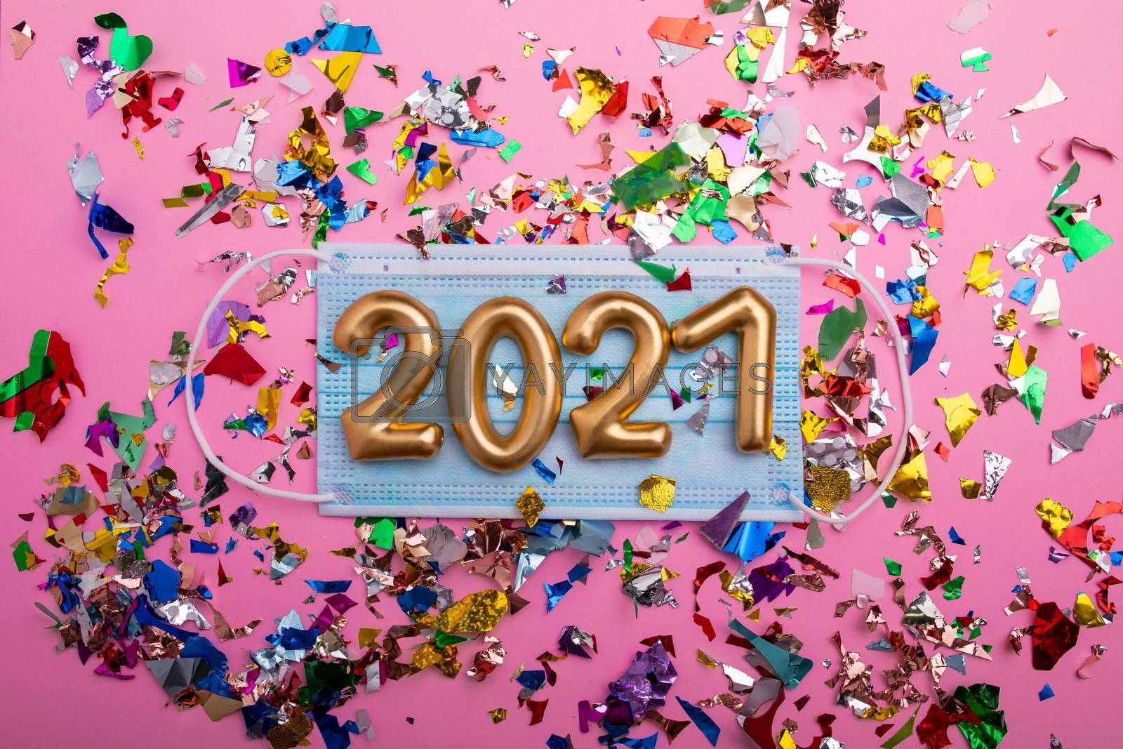 Numbers 2021 with face mask and confetti - Happy new year! by adamr