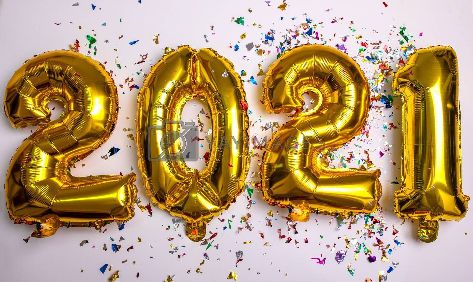 2021 concept new year from golden foil balloon and confetti stock photo