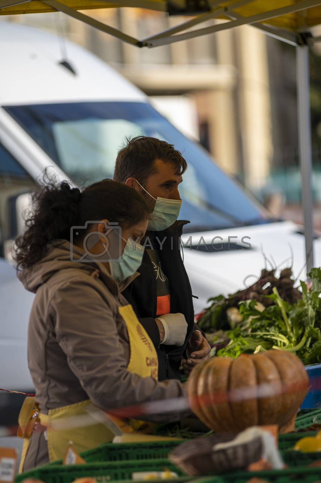terni,italy october 23 2020:walking man and woman at the market selling vegetables