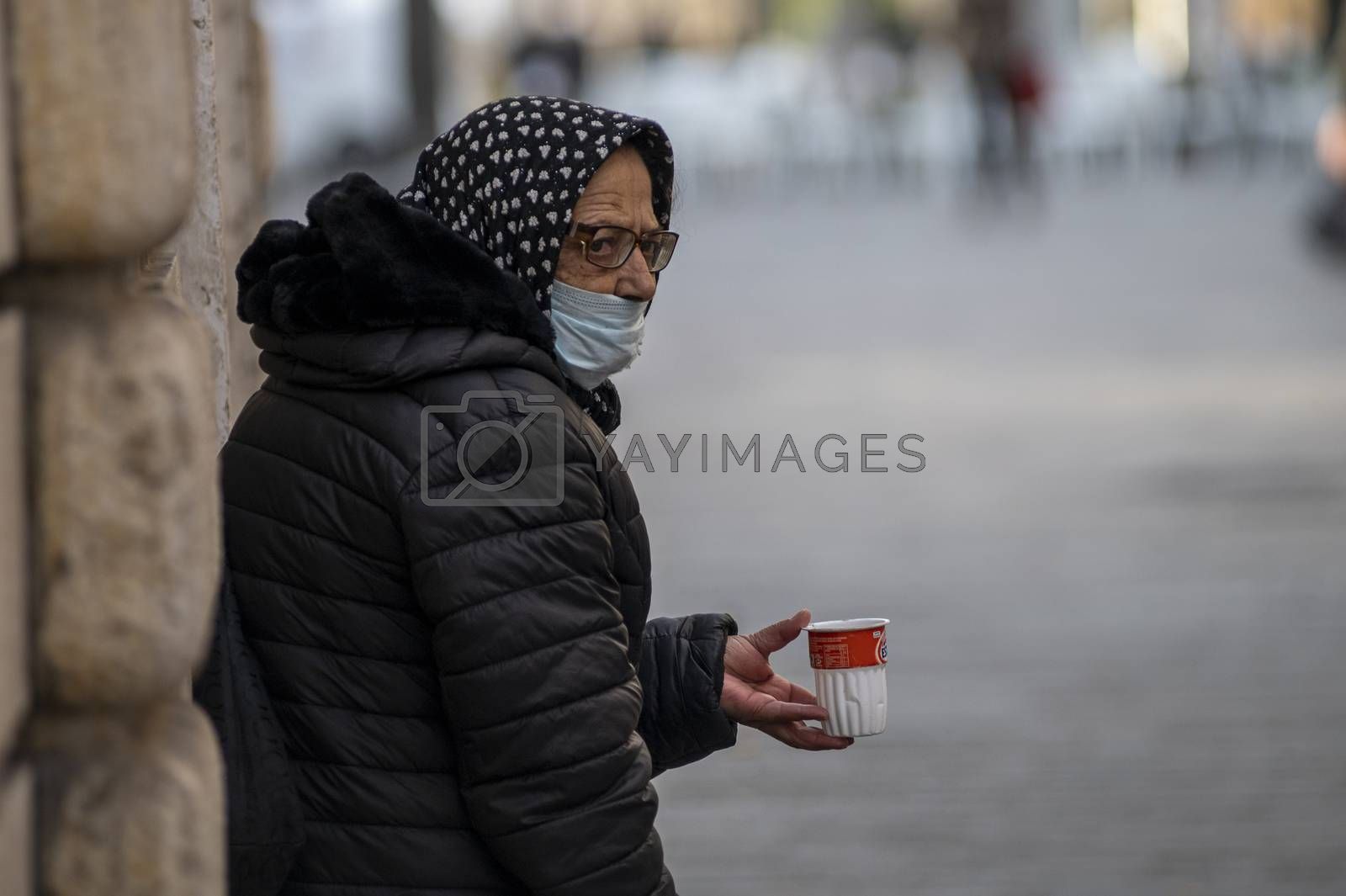 terni,italy october 23 2020:woman begging with medical mask in city center