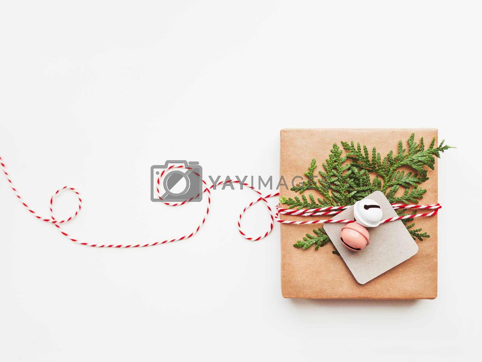 Christmas DIY presents wrapped in craft paper with fir tree branches and red hearts. Top view on decorations on New Year gifts. Festive background. Winter holiday spirit. Banner with copy space. by aksenovko