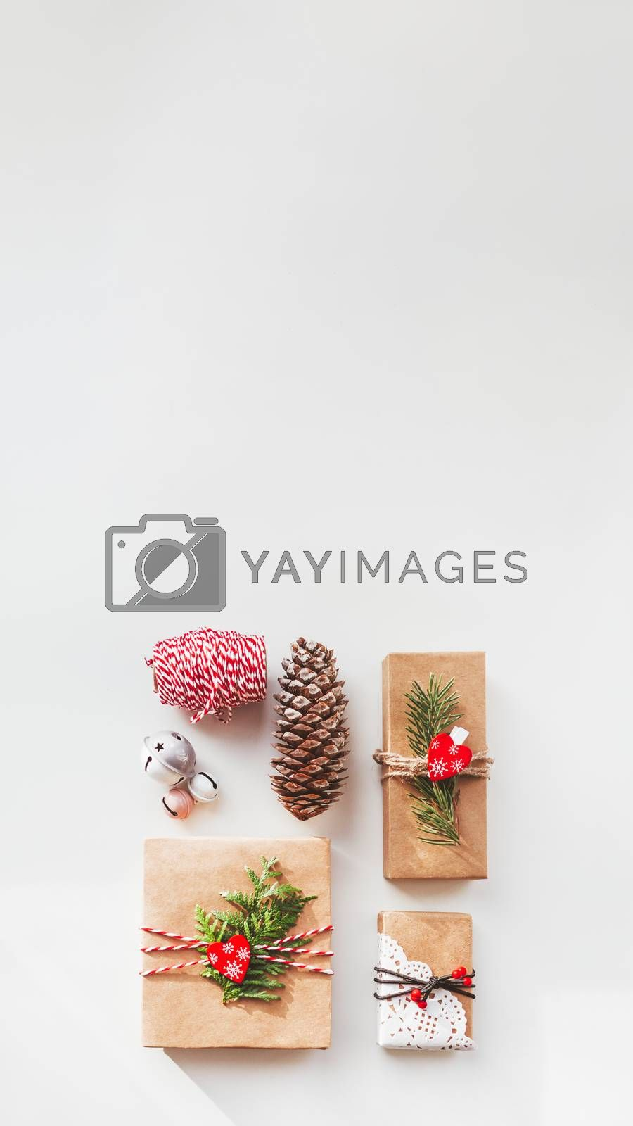 Christmas DIY presents wrapped in craft paper with fir tree twig by aksenovko