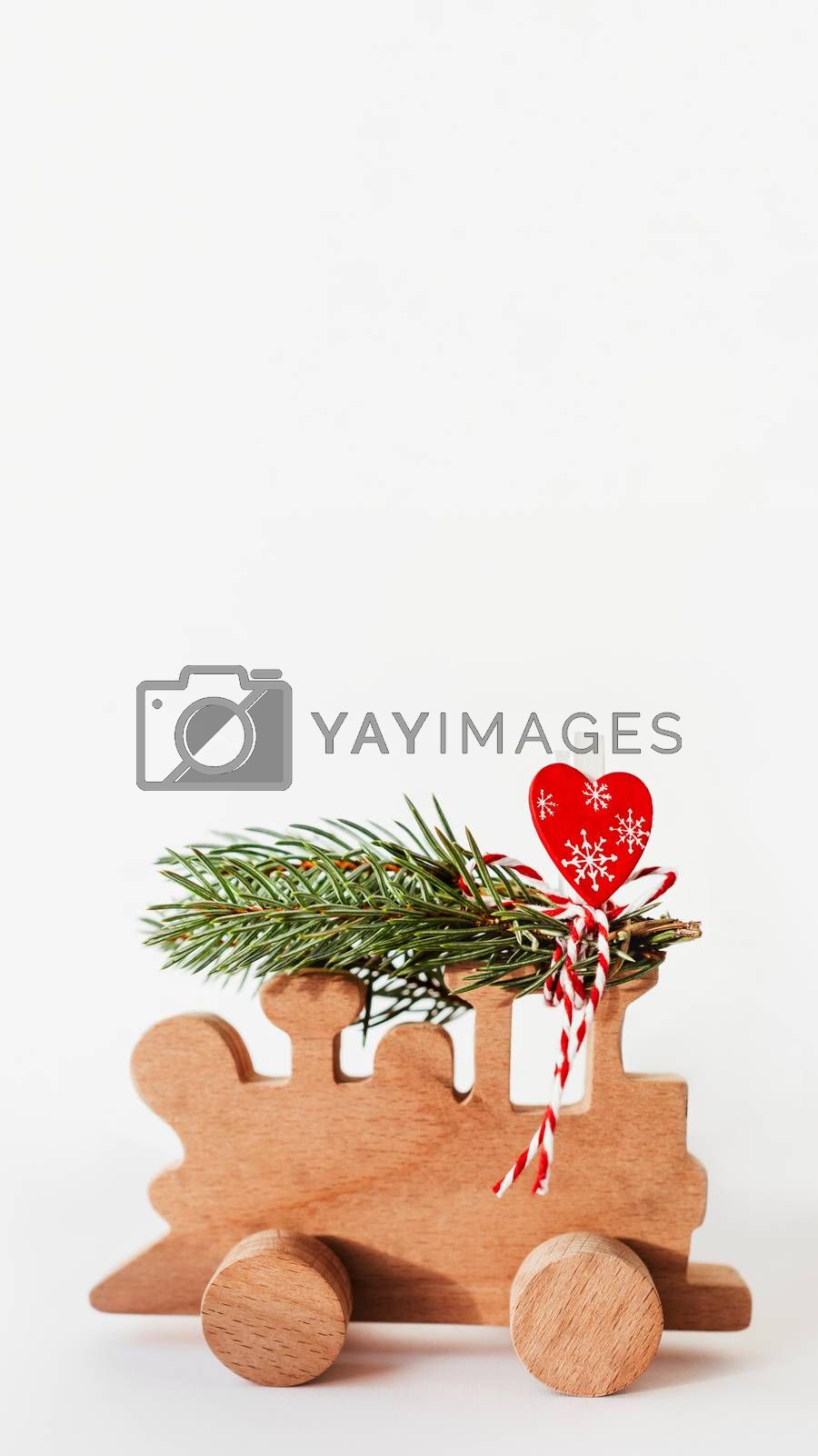 Wooden train with tied fir tree branches and red heart decoratio by aksenovko