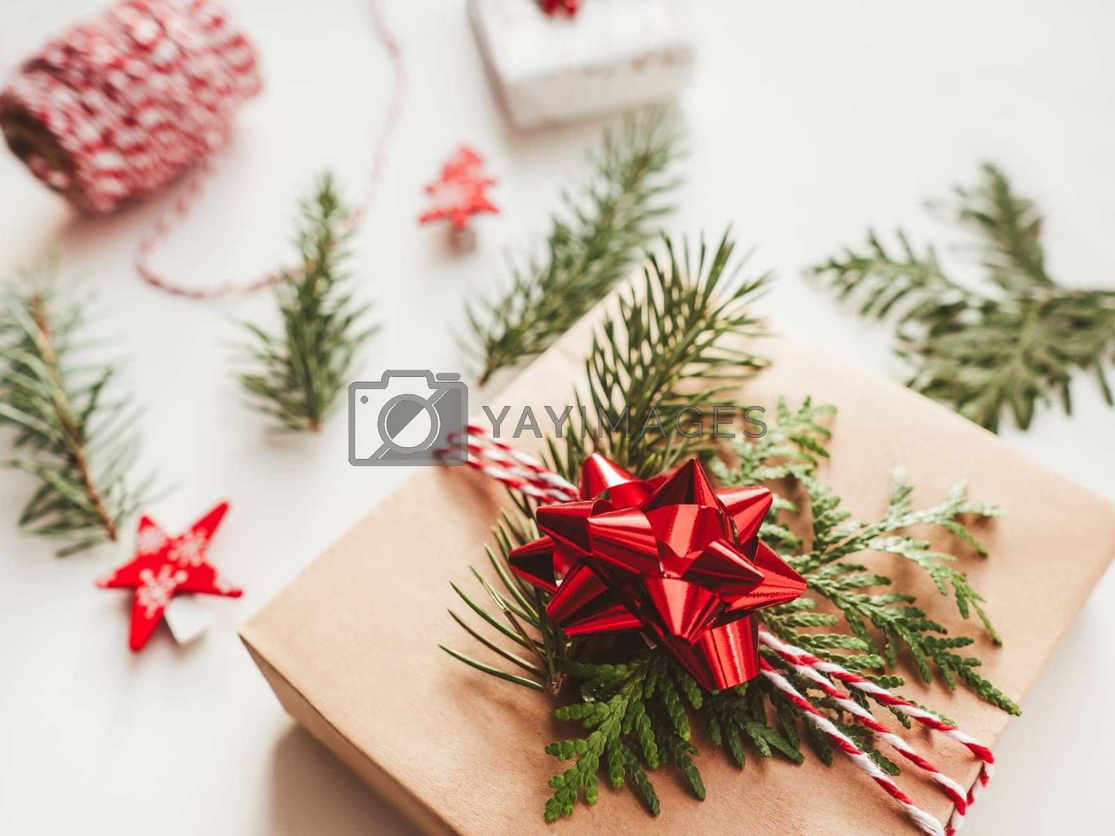 Christmas DIY presents wrapped in craft paper with fir tree bran by aksenovko
