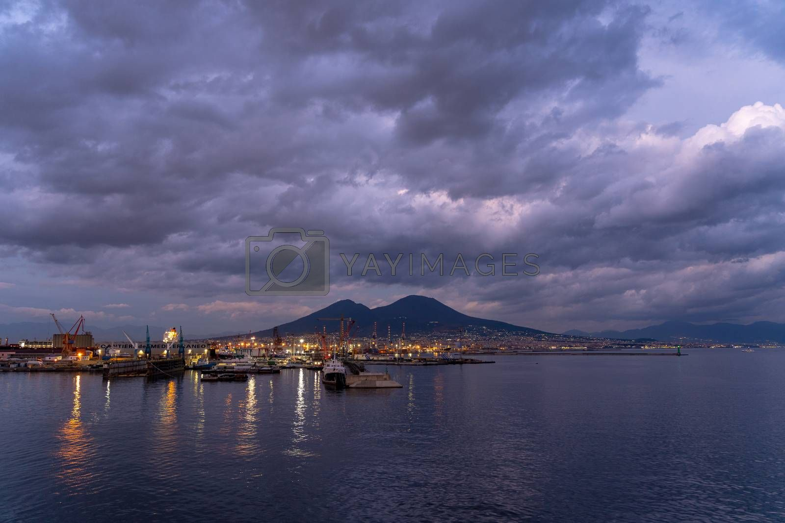 Royalty free image of Naples harbor at sunset with Vesuvius volcano, Italy. by maramade