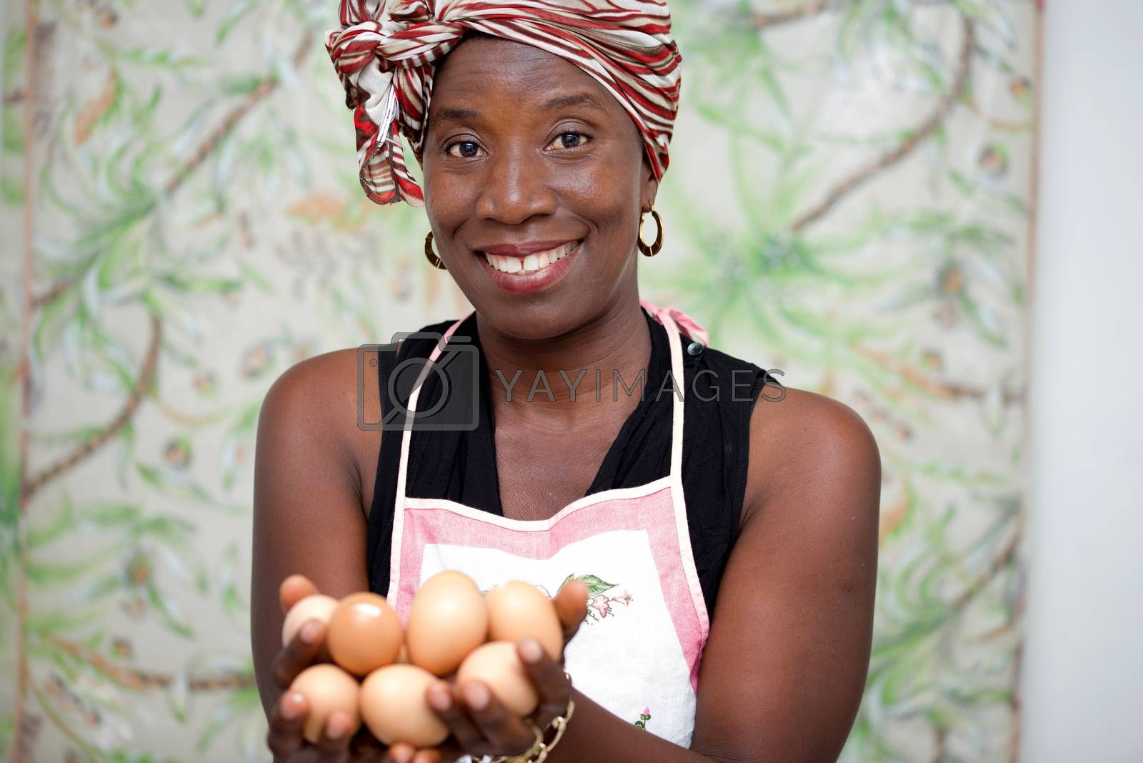 young smiling woman holding eggs in the hand by vystek