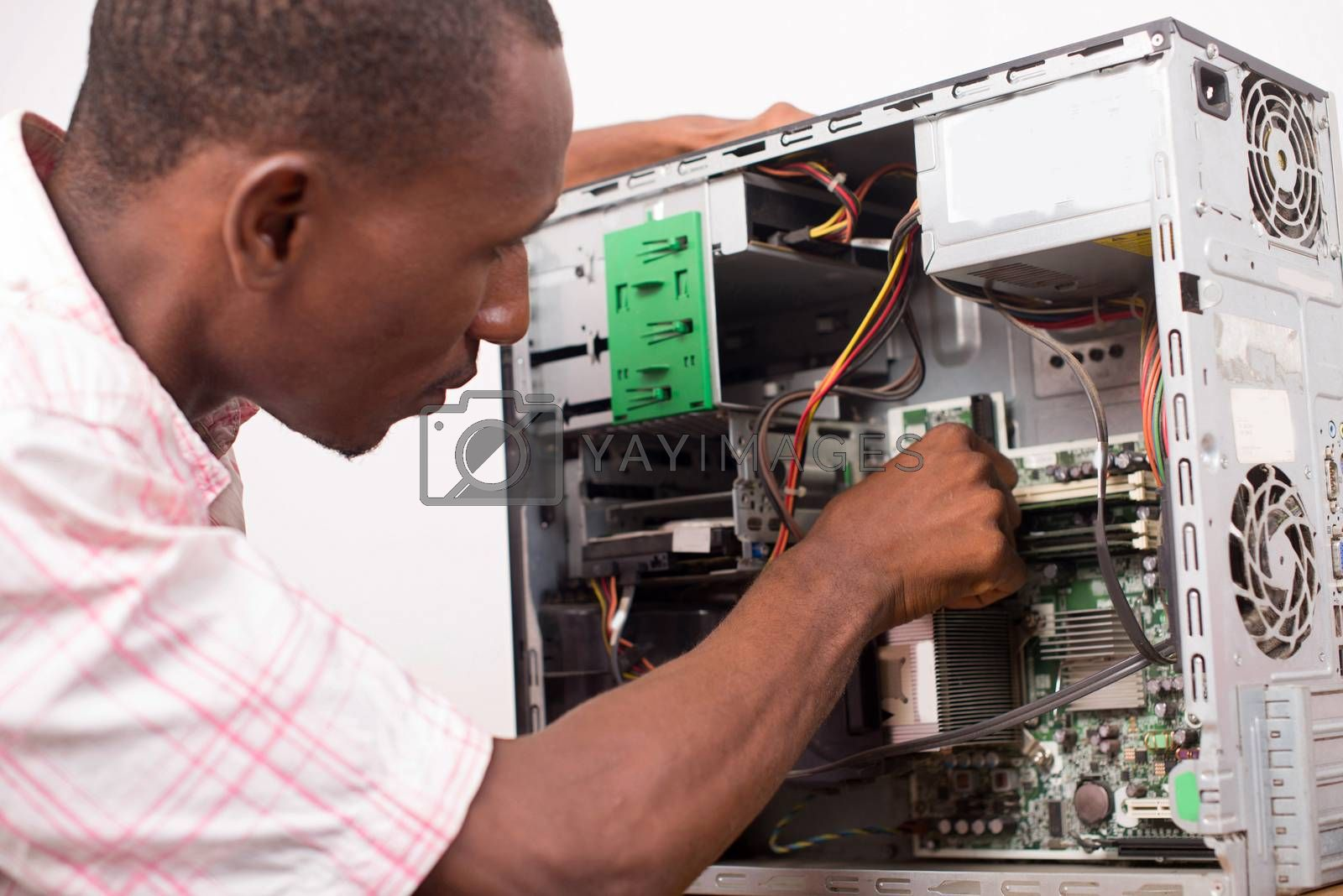 technician repairing computer equipment. by vystek