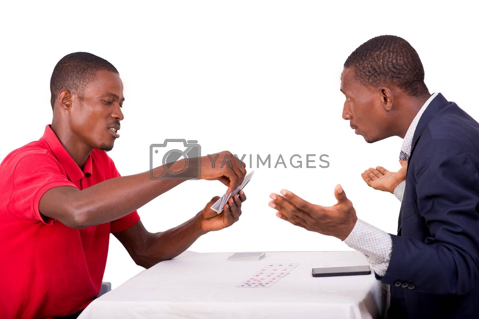 Young men playing cards at the game table, young people having funny concept and happy to have won at the card game.