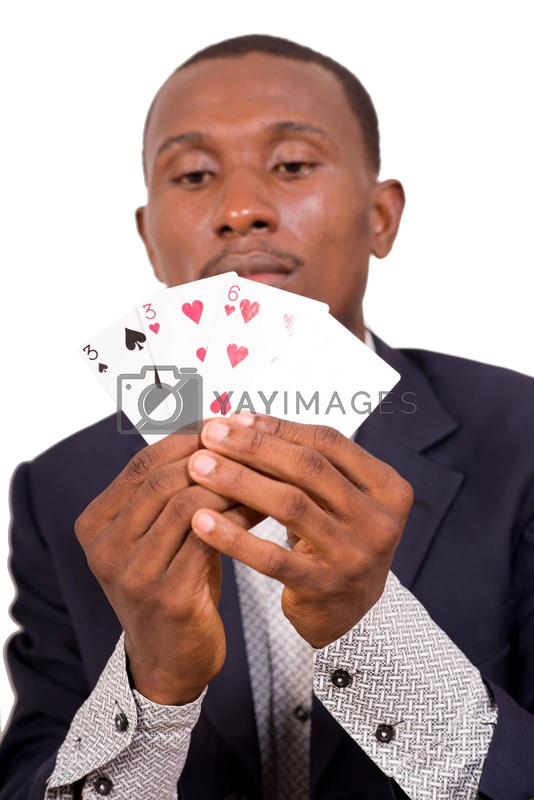 Young man in suit, shows in his hands different card game. Big plan on cards.