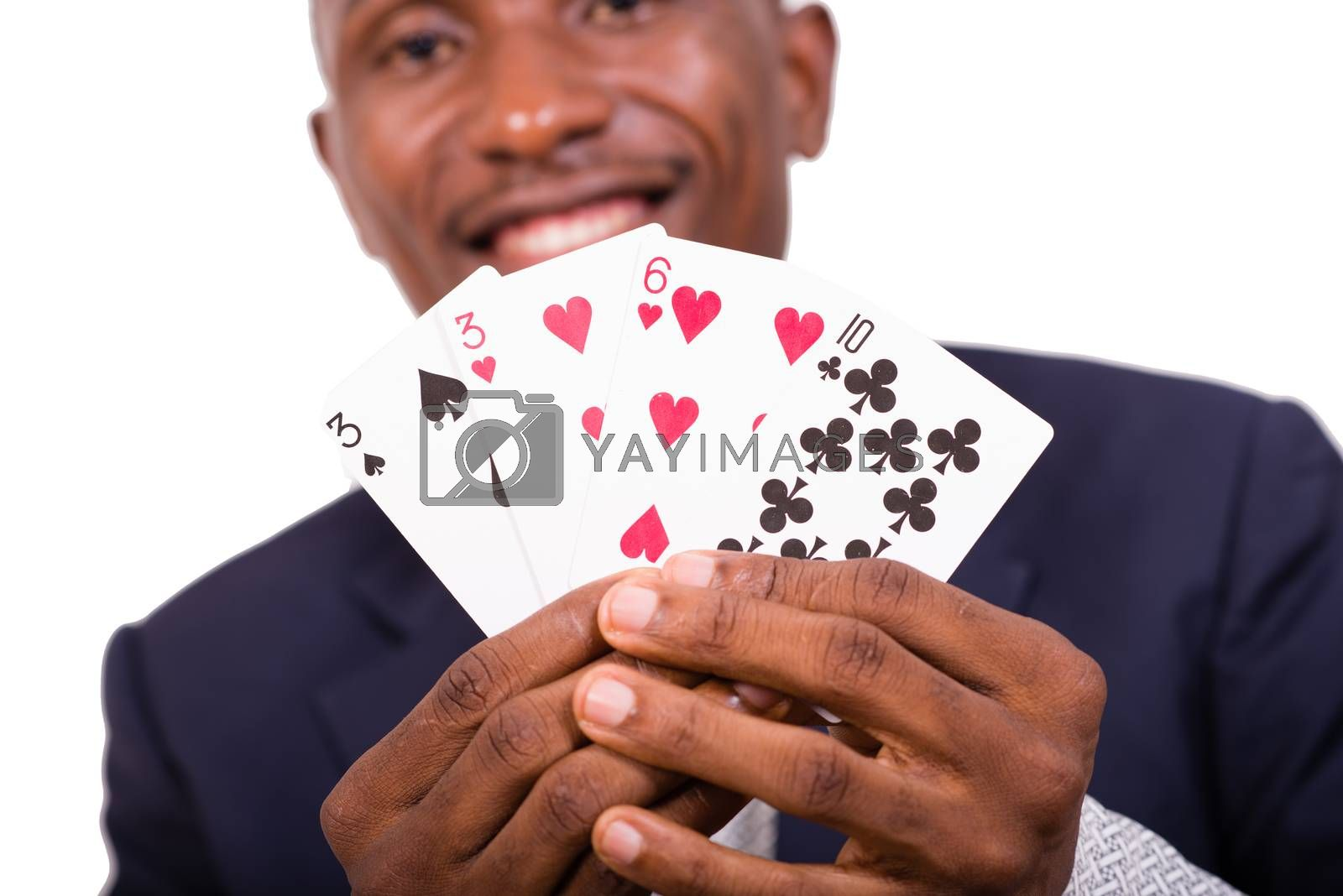 Young man in suit, happy shows in his hands different card game.Large shot on cards.