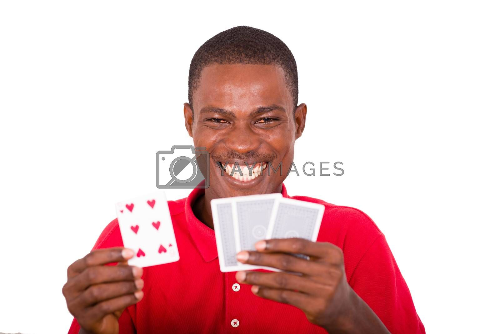 smiling and funny man showing cards in his hands.and offers to play,close-up on the cards.