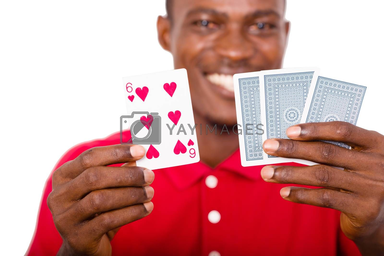 Young man smiling and happy shows in his hands playing cards.close-up on the cards.