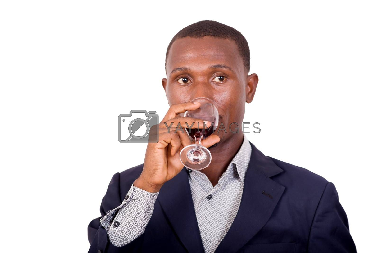 Man in suit standing in studio on white background enjoying  a glass of red wine