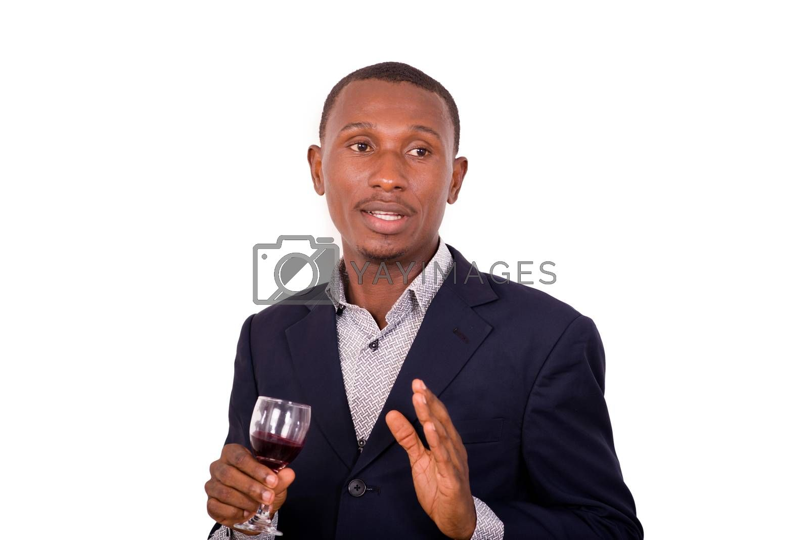 portrait of young happy businessman holding a glass of red wine isolated on white background.
