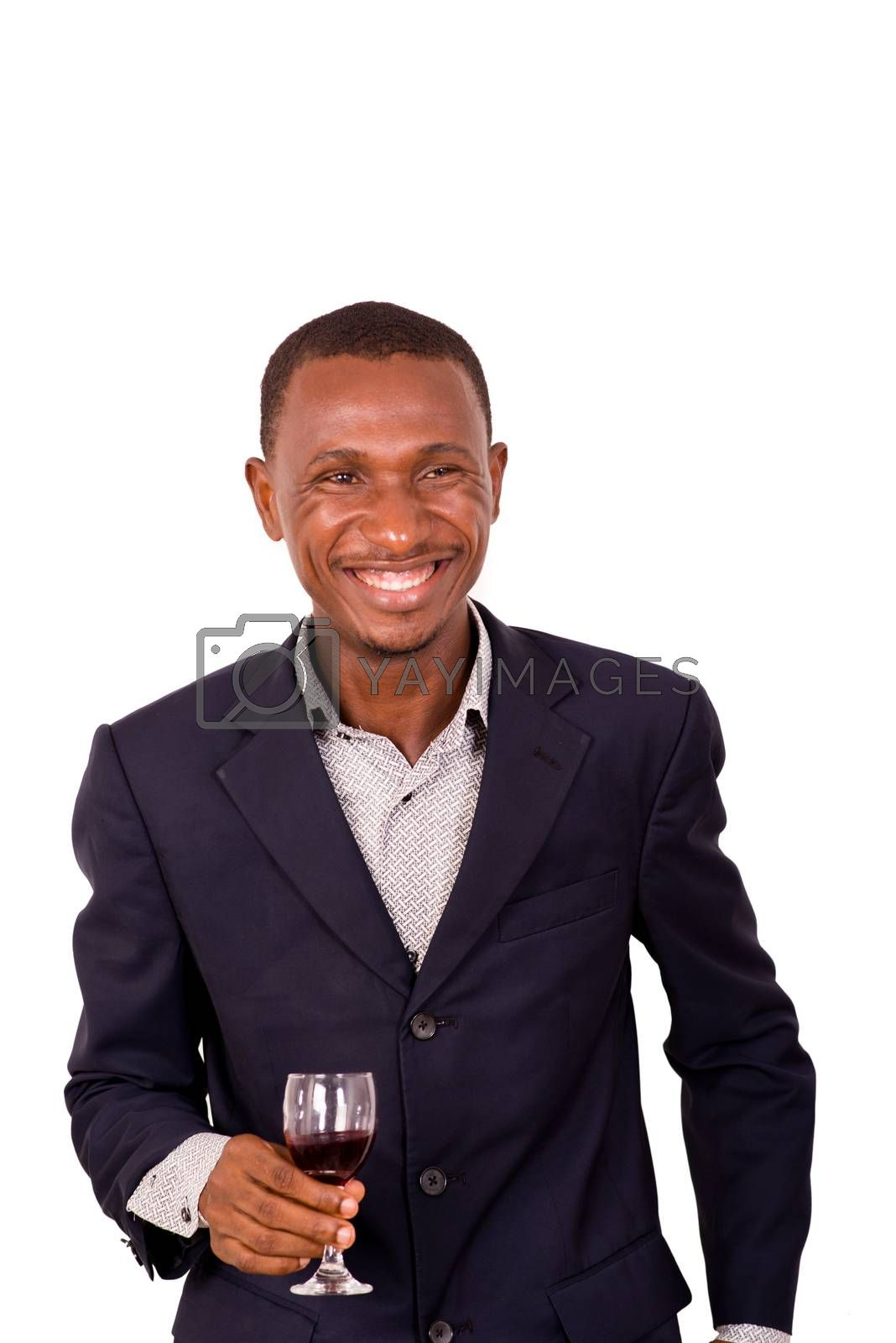 portrait of young happy businessman in suit standing on white background.