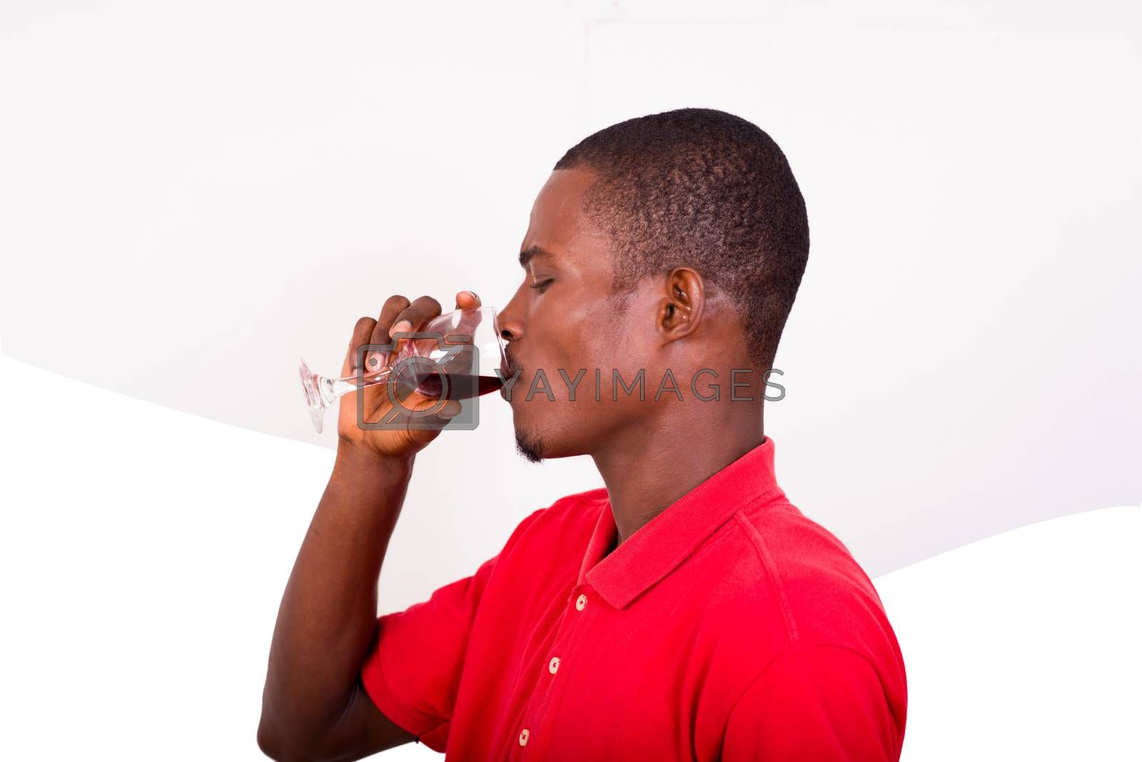 portrait of young man in red profile tee-shirt drinking red wine isolated on white background.
