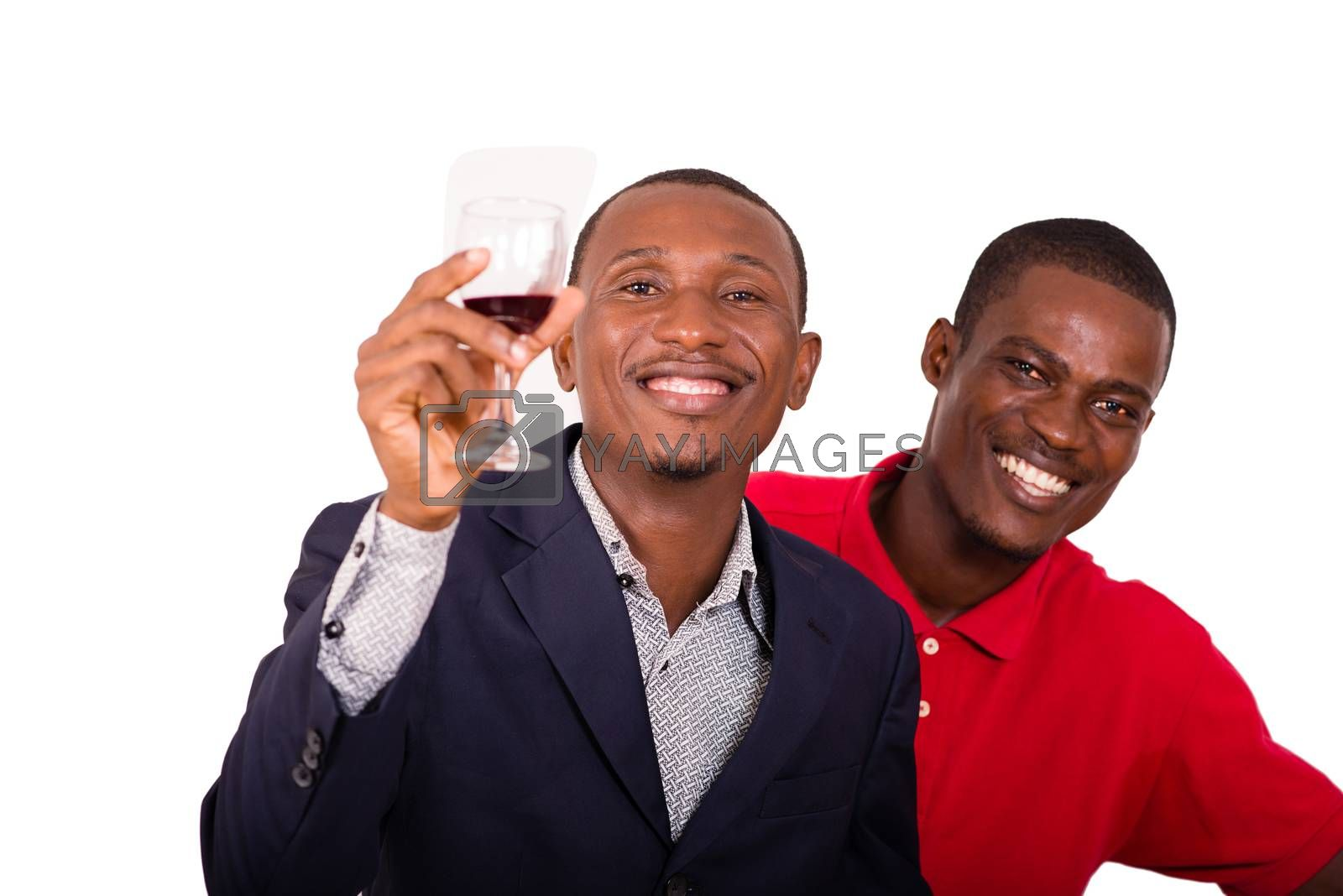 Young happy people toasting with wine for a party in studio on a white background
