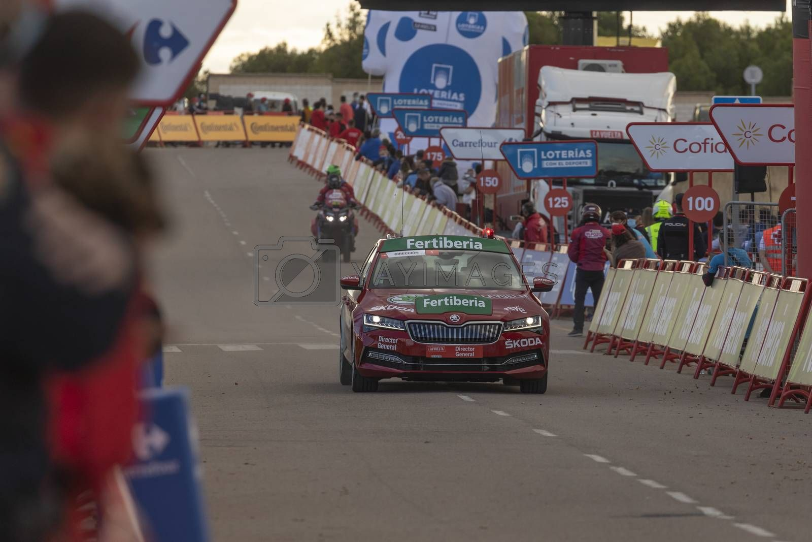 Arrival safety car of the cyclists peloton, in the area of the finish line of the fourth stage of La Vuelta a España 2020.