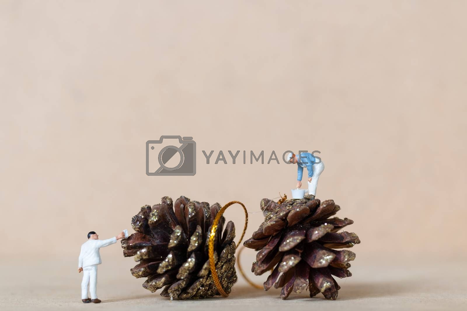 Miniature people,  Worker team painting a Christmas decoration , Christmas and Happy New Year concept.