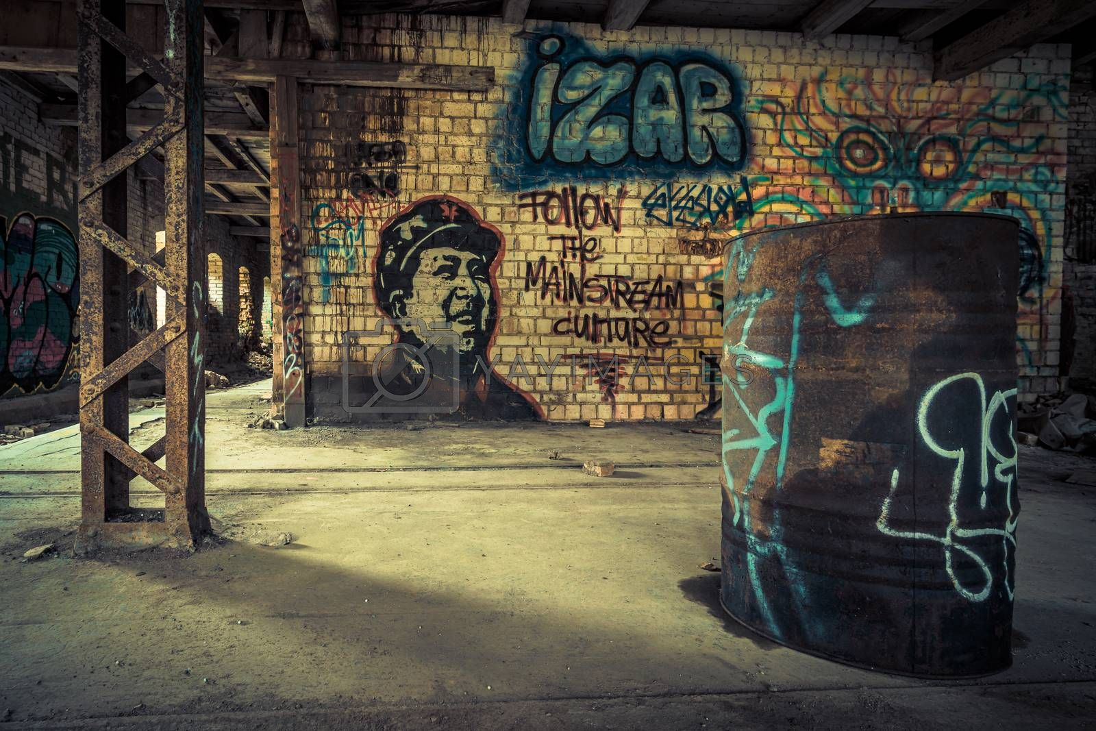 An old abandoned brick factory, a lost place with ancient history, vandalism and graffiti by mindscapephotos
