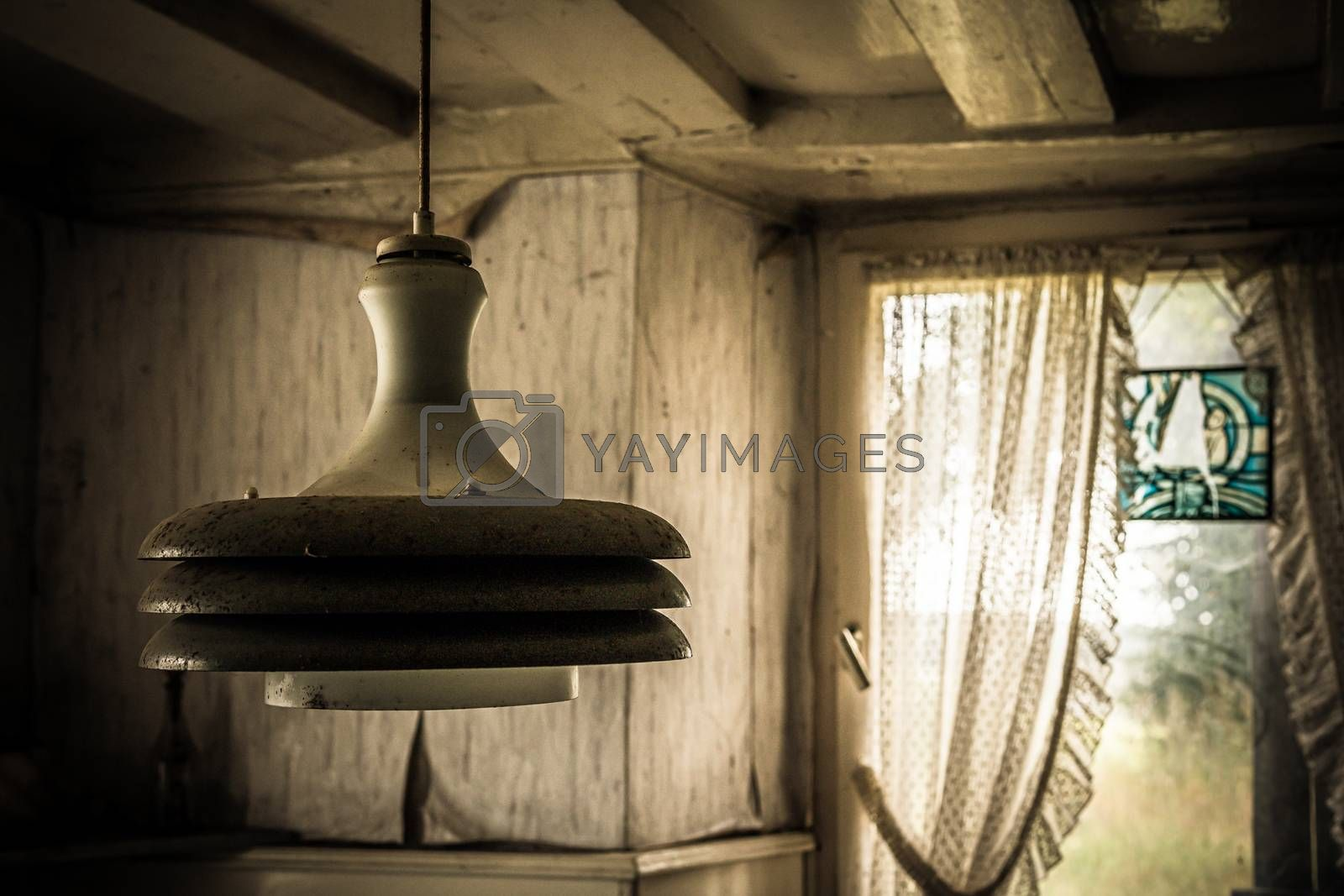 An old abandoned farm house, a lost place with dirty furniture and dusty paintings by mindscapephotos