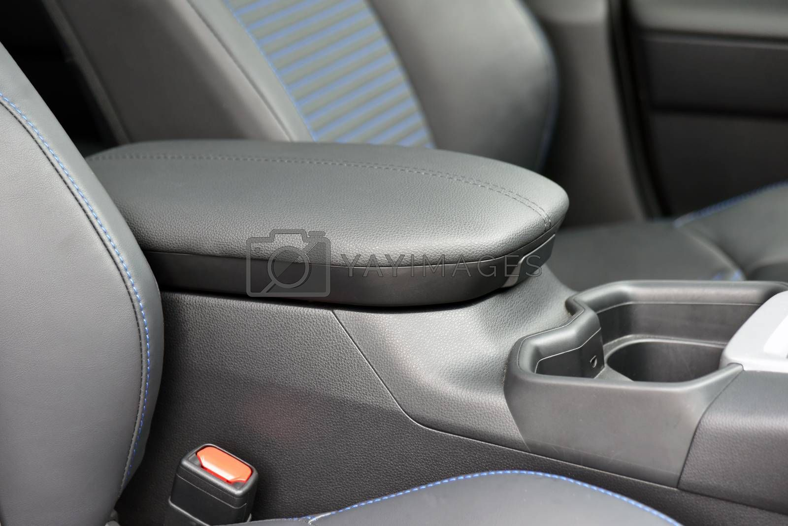 Royalty free image of Armrest in the luxury passenger car between the front seats by aselsa