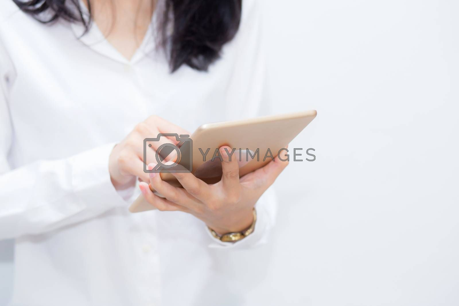 Closeup woman using tablet computer in the cement background, businesswoman looking tablet, communication concept.