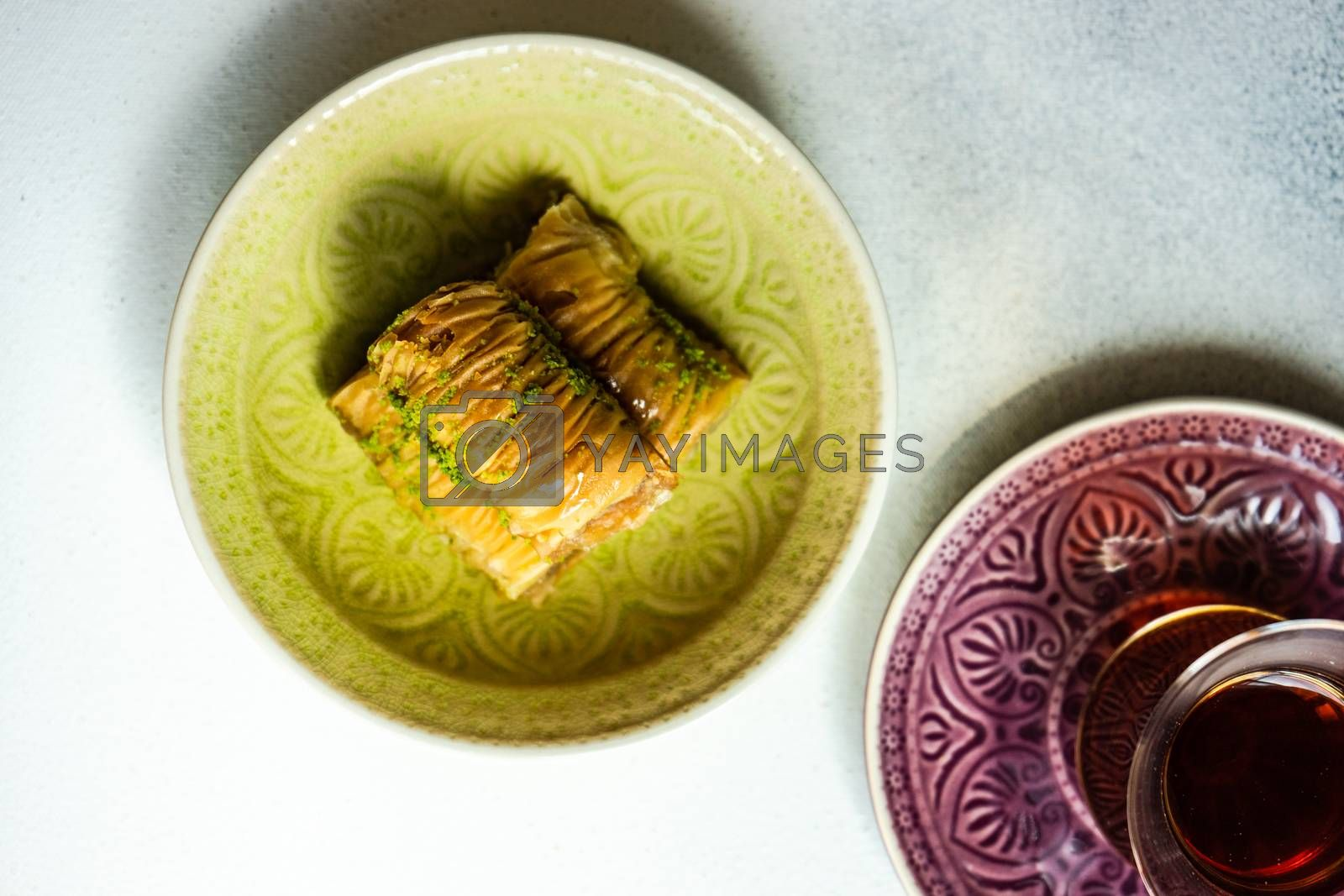 Famous turkish or oriental delight Baklava served with black tea