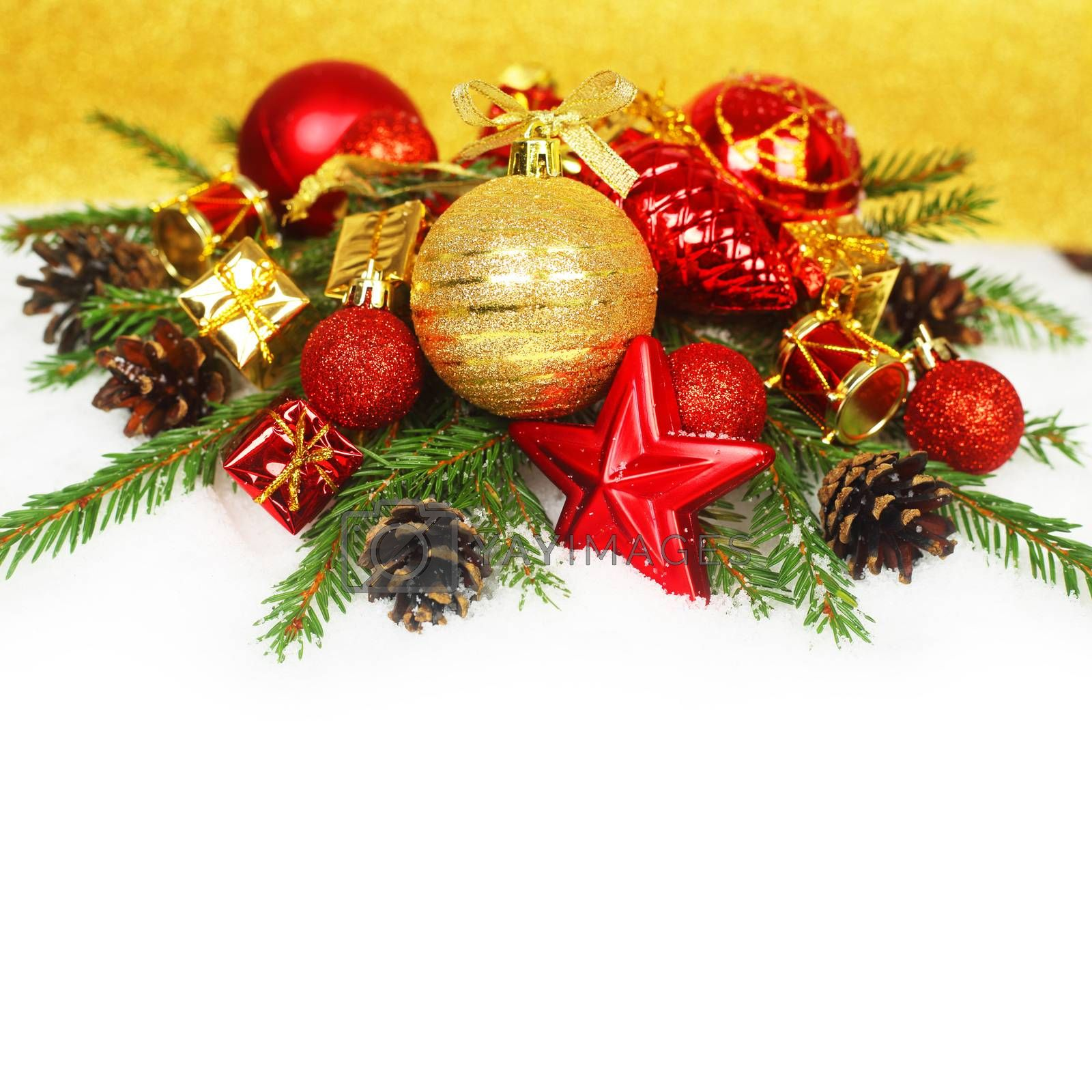 Christmas card with red baubles and gifts on golden bokeh light background with copyspace