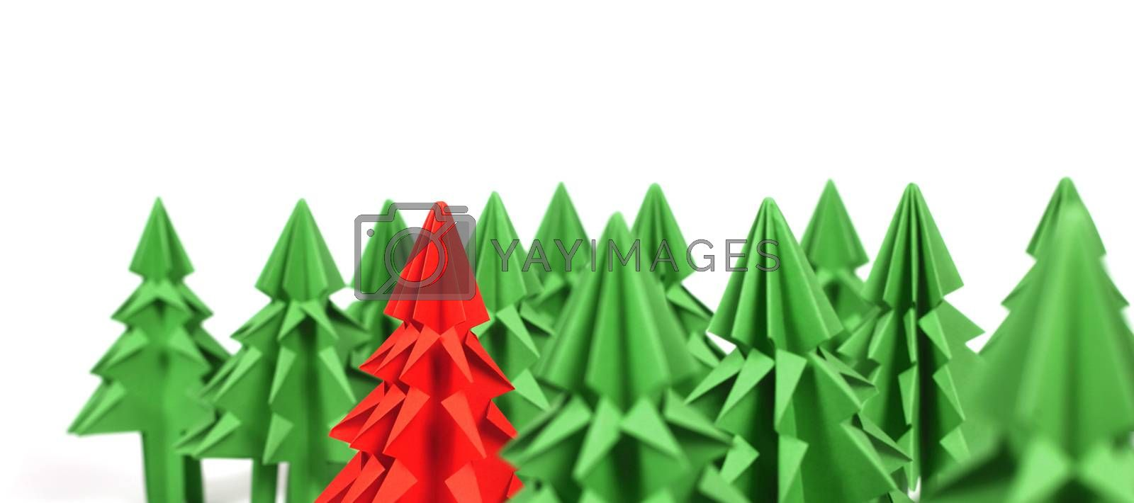 Origami Christmas trees of green craft paper isolated on white background