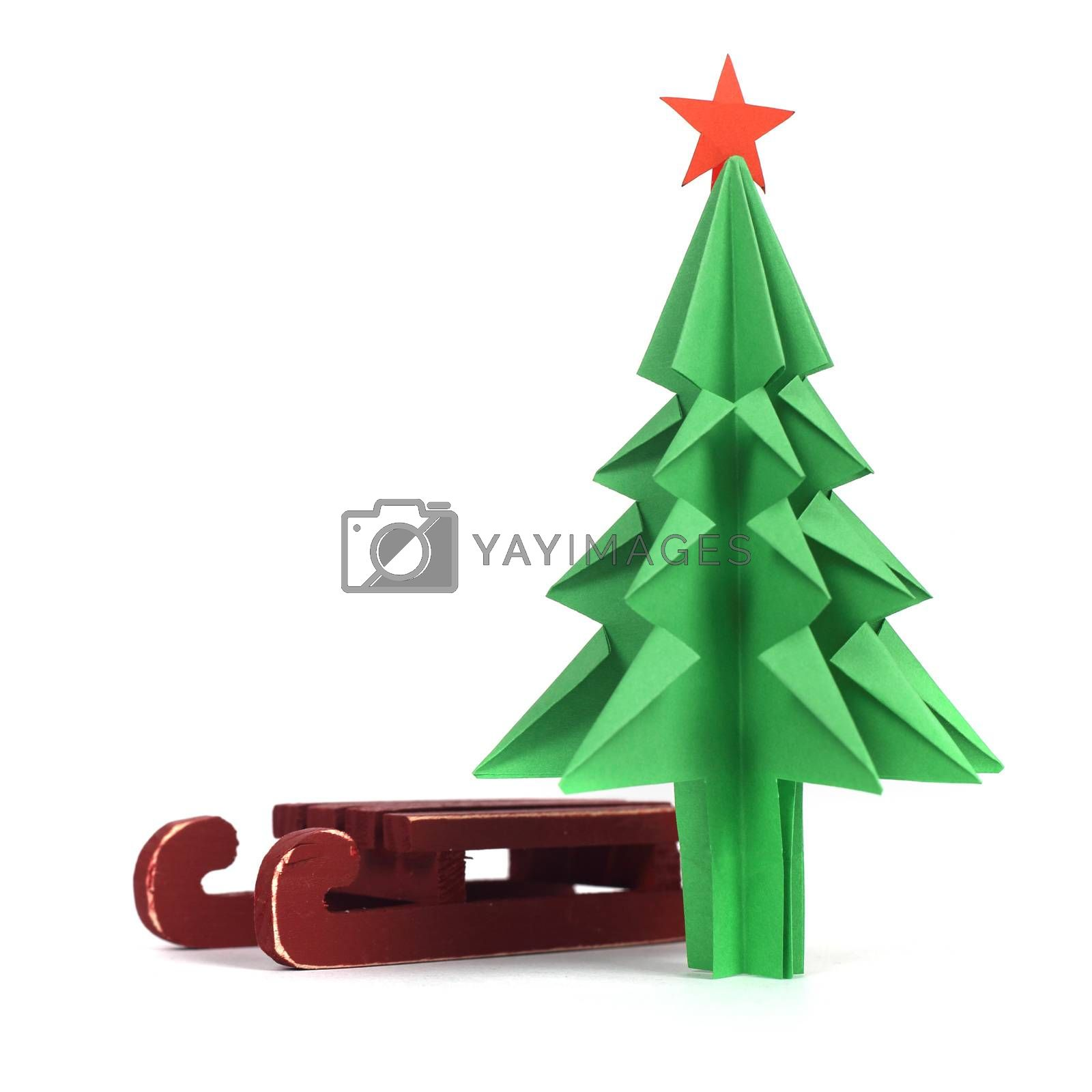 Origami Christmas tree of green craft paper isolated on white background