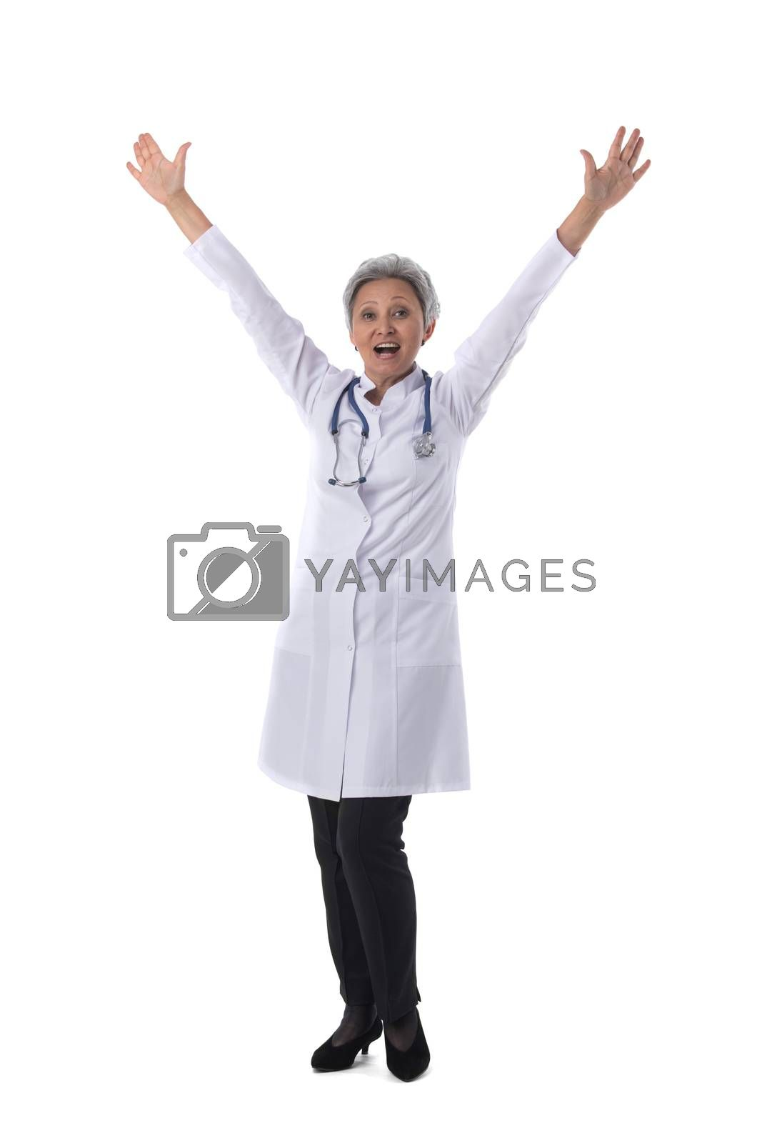 Asian mature female medical doctor with stethoscope with raised arms isolated on white background
