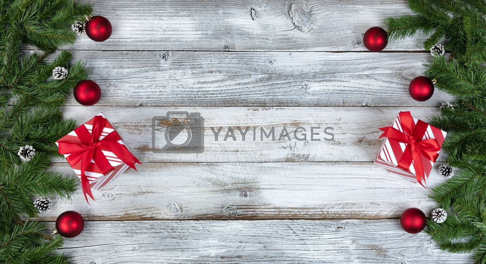 Christmas or New Year holiday theme background with evergreen branches and other decorations on both side borders