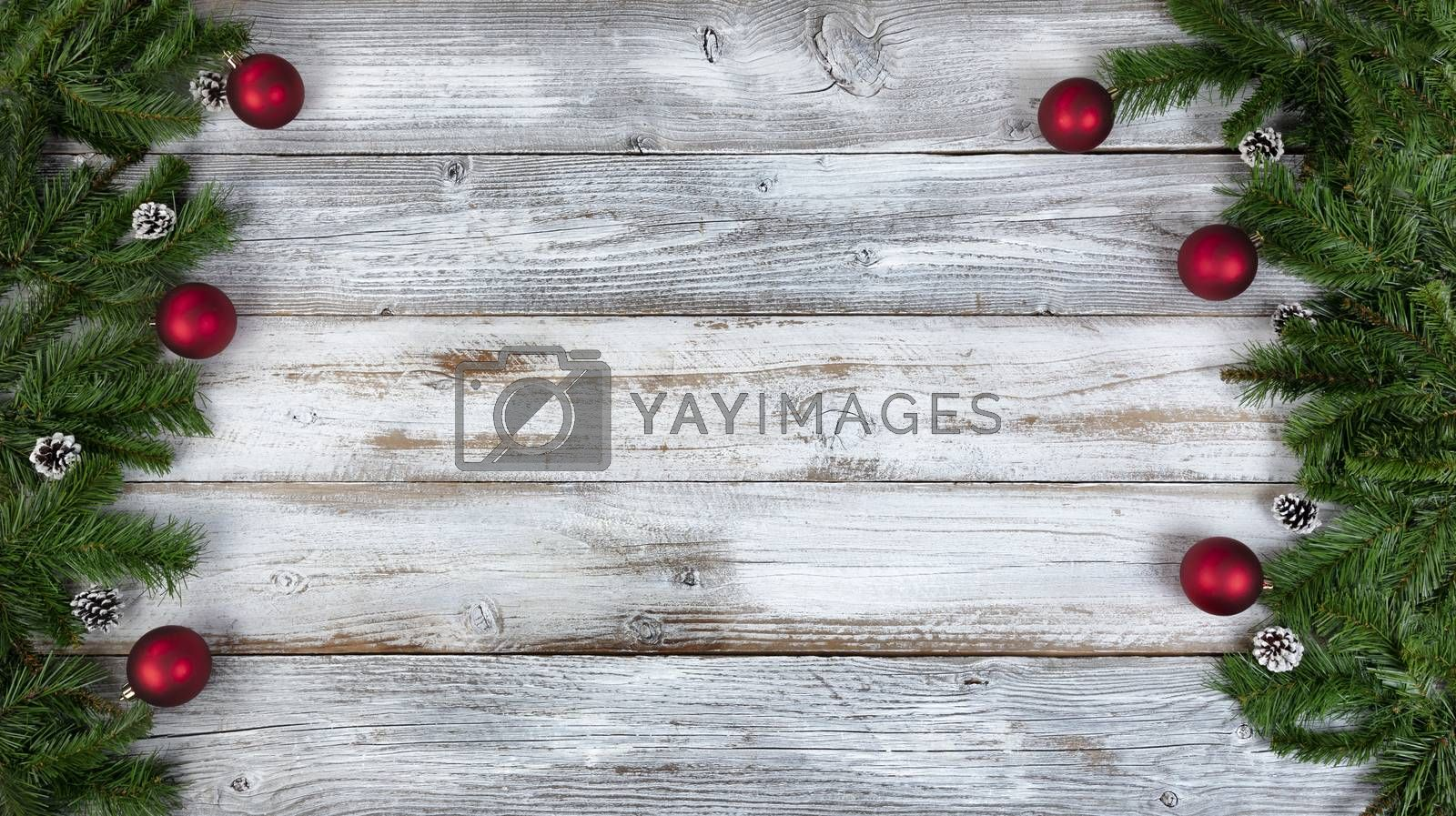 Christmas or New Year holiday theme background with evergreen branches and other decorations