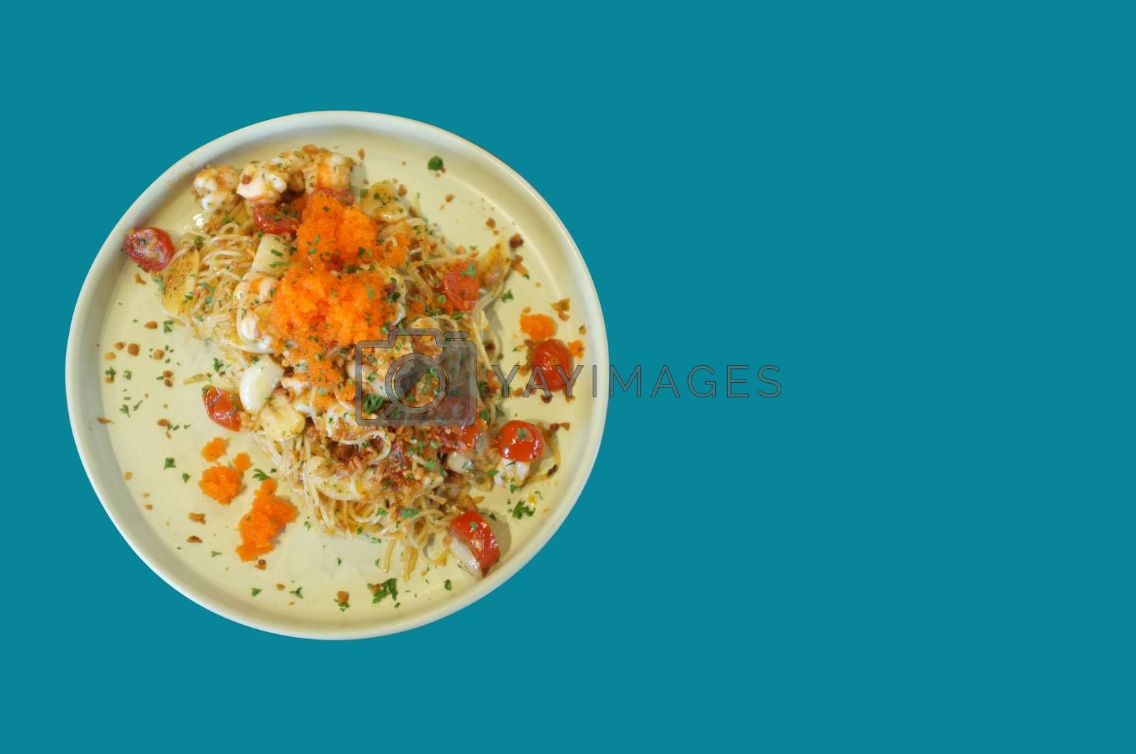 fusion food style , Cream sauce spaghetti egg shrimp on blue background