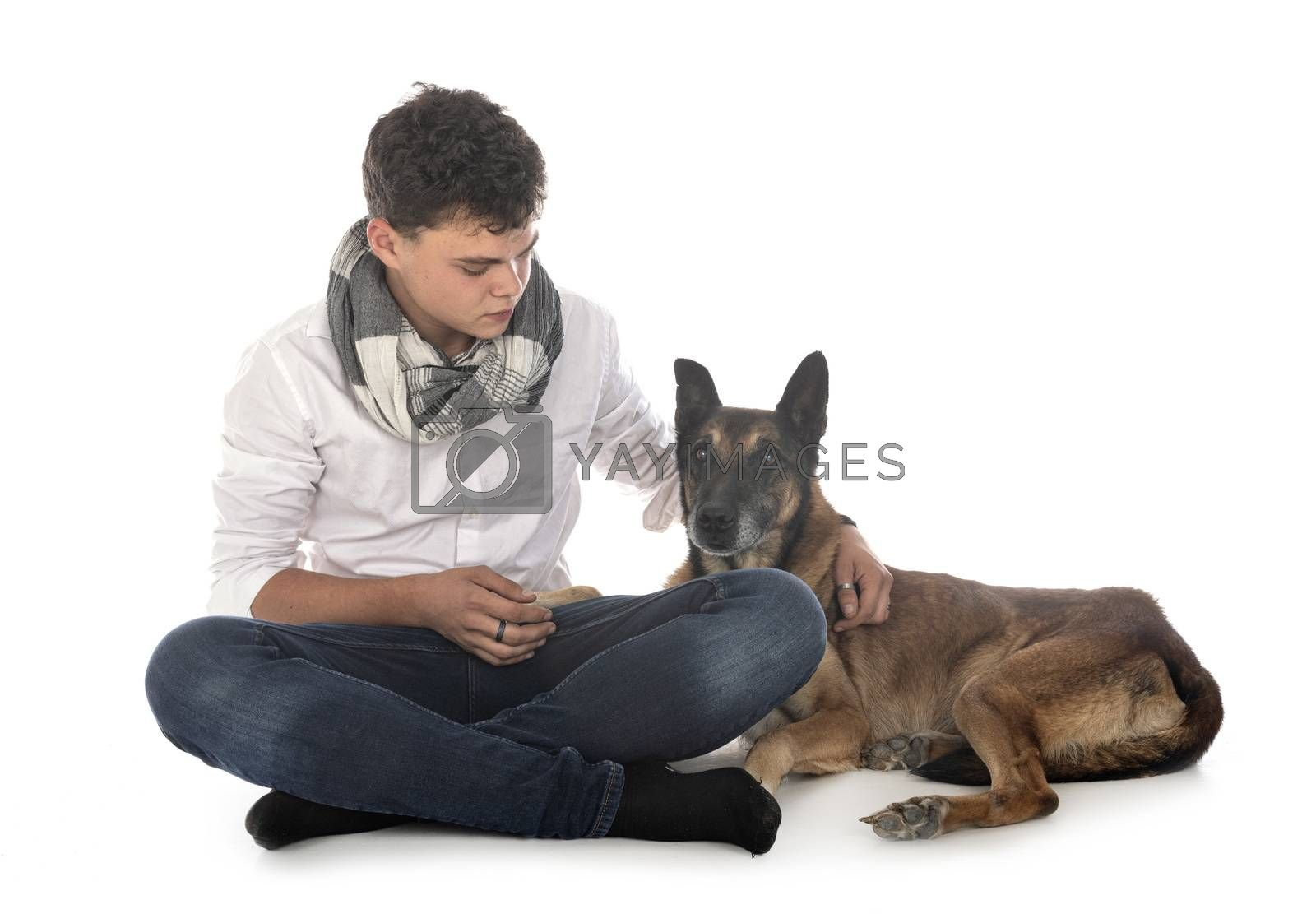old belgian shepherd and owner in front of white background