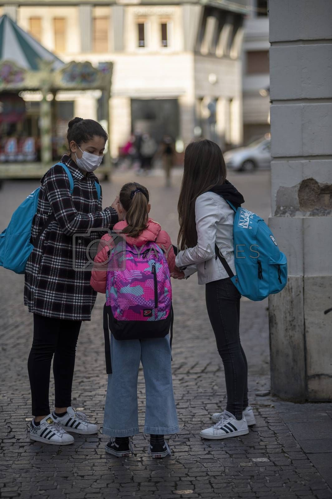 terni,italy october 26 2020:children who go to school with backpack and medical mask cause covid 19