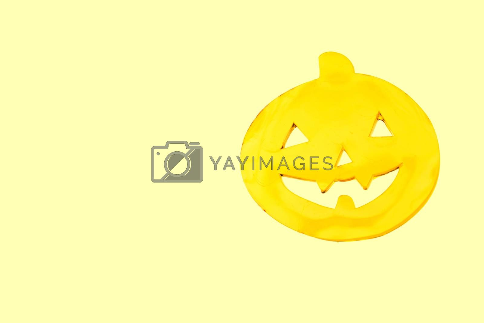Pumpkin with face drawn for halloween.