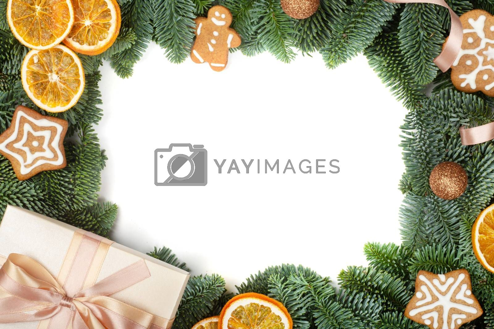 Christmas design boder frame greeting card of noble fir tree branches gift and gingerbread cookies isolated on white background