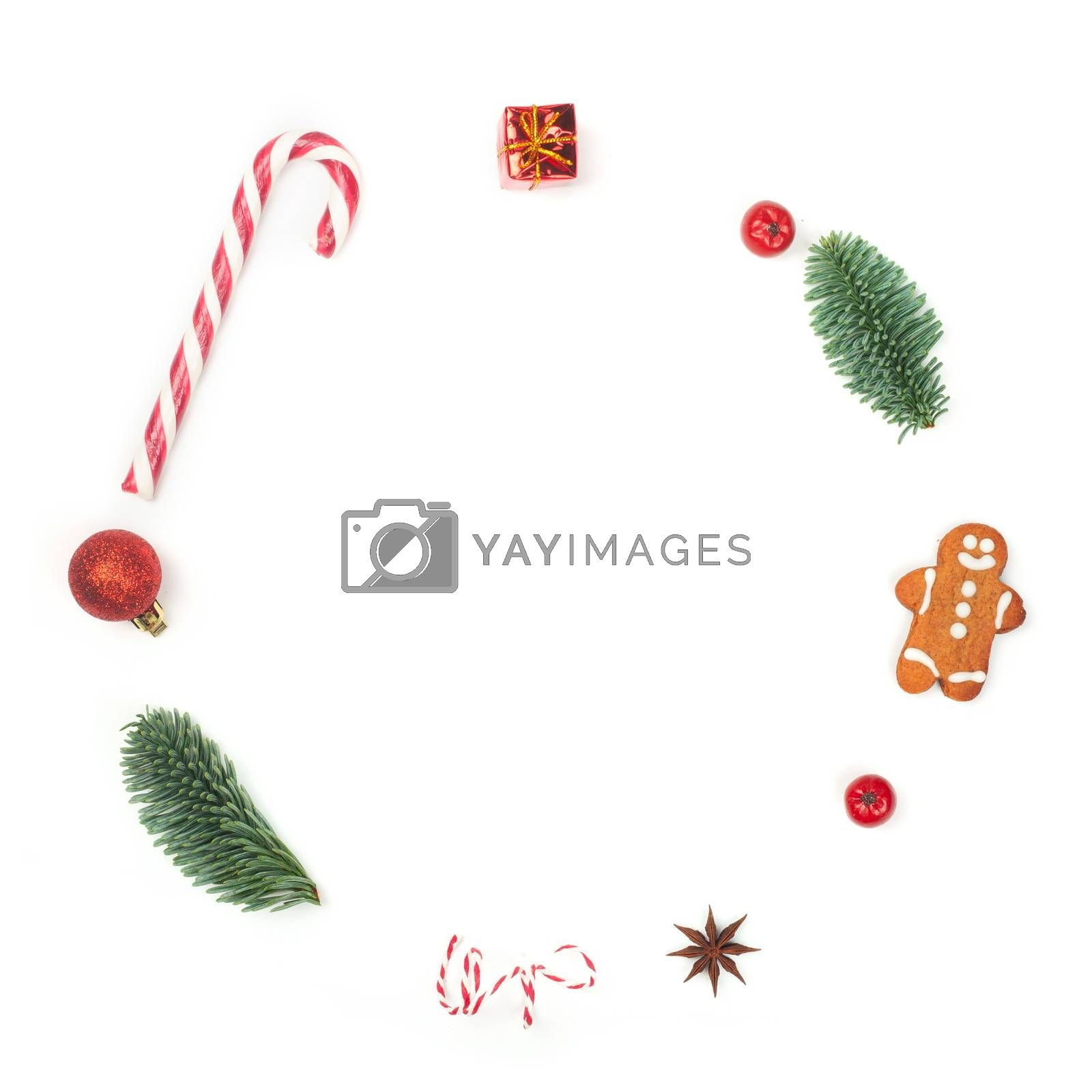 Christmas decorative minimalistic conceptual wreath with noble fir tree twigs and baubles objects design top view isolated on white background. New Year concept.