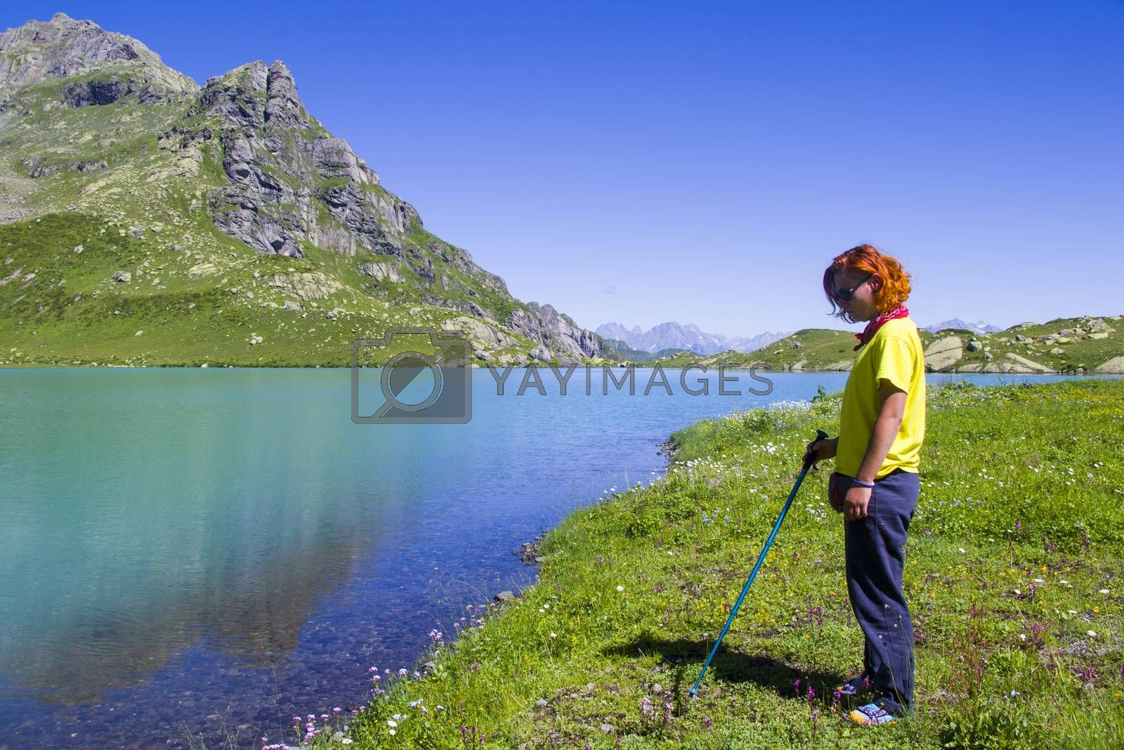 Hiker and backpacker in the mountain valley and field, trekking and hiking scene in Svaneti, Georgia, young and adult woman.