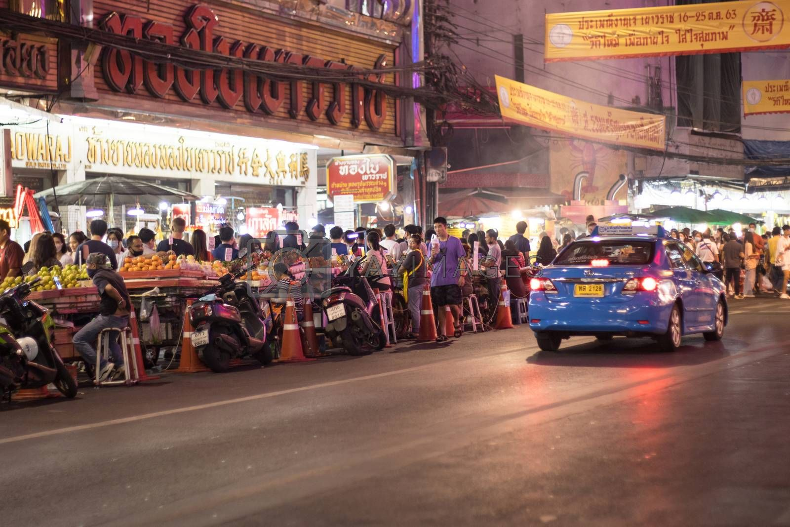 Bangkok Thailand - Oct 24, 2020 :- a lot of people, walking at Street food of Bangkok Some street vendors operate in groups the same place every night and have a different choice of meal