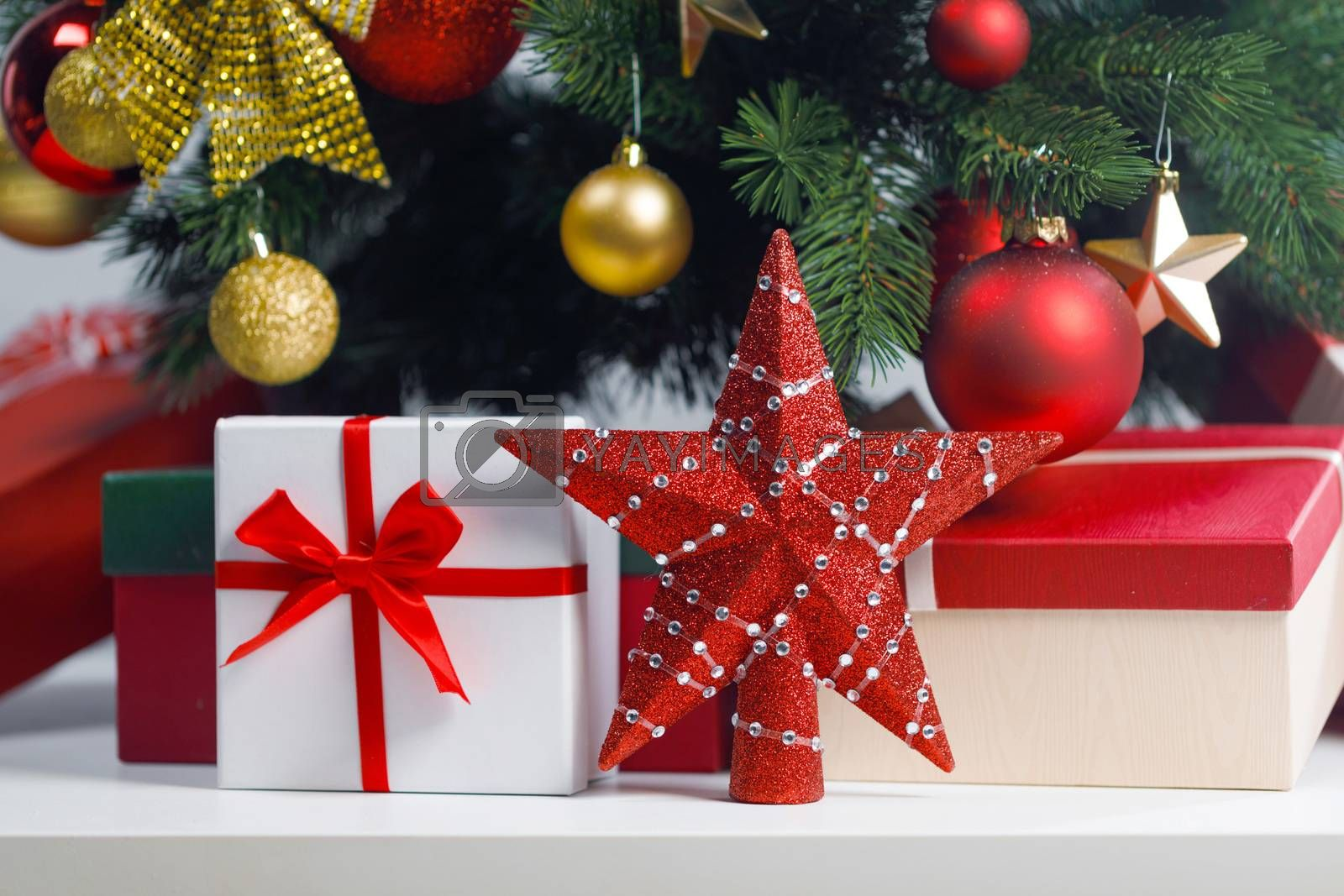 Christmas gifts and red decorative star on white background
