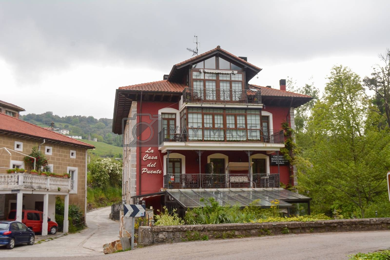 Regules, Spain, May 2018: Street view on hotel and bed and breakfast Casa Del Puente next to gandara river