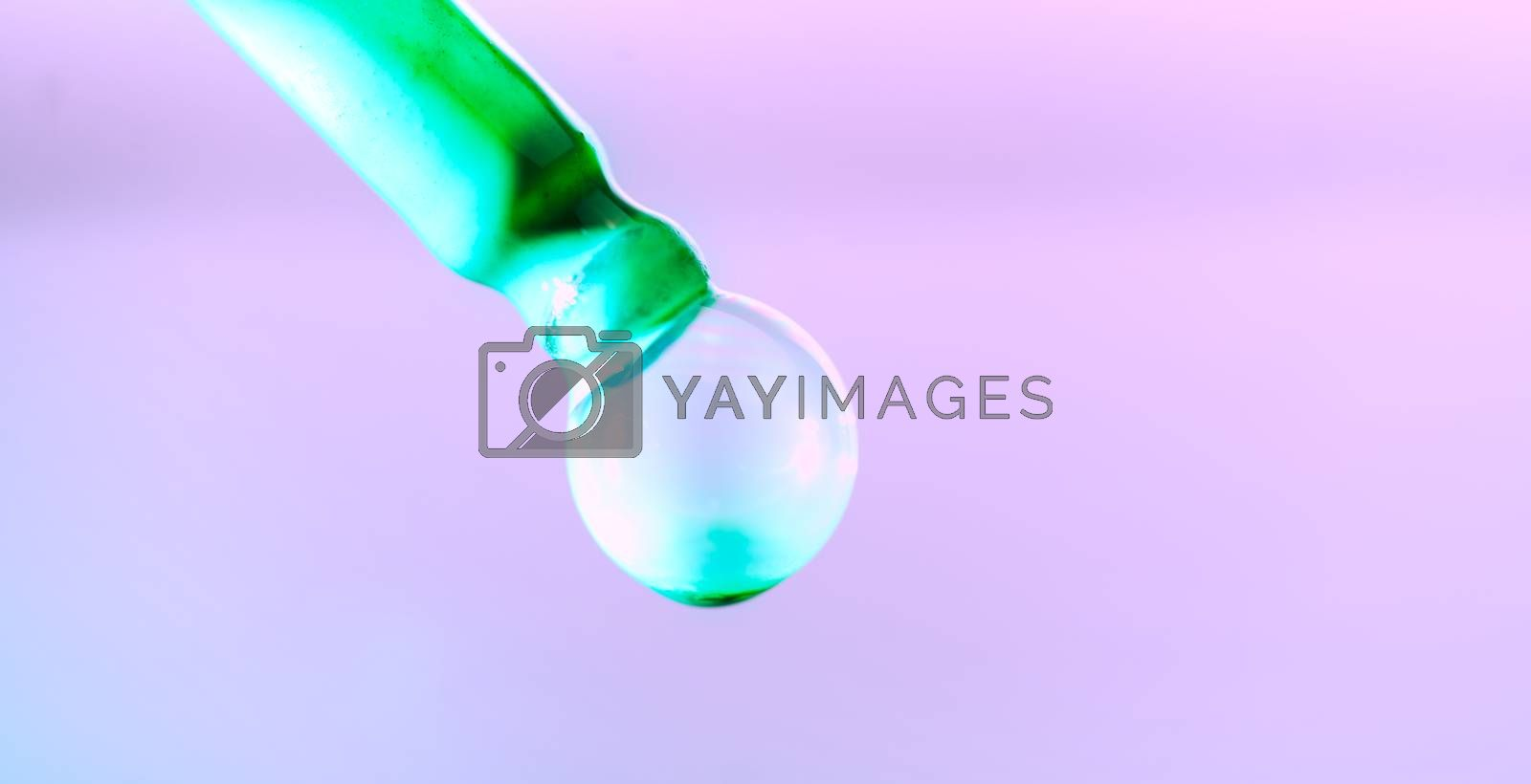 Color drop tube science and art experiment drop color into green template green concept background.
