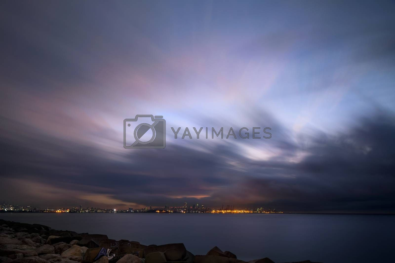 The Coastal Town is Visible in the Distance. Long Exposure of the Night Sky over the Mediterranean Sea. The Delightful Beauty of Lebanon.