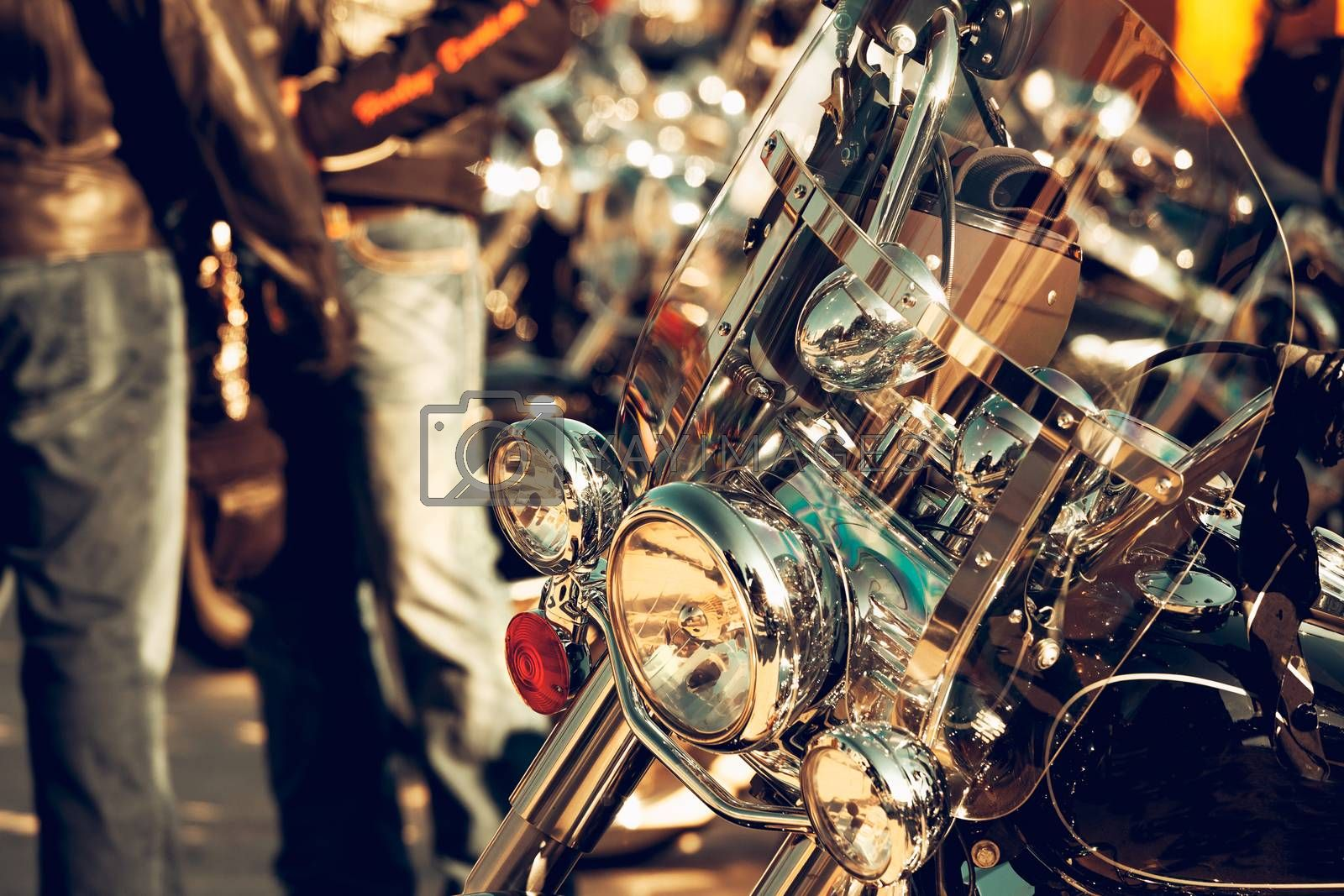 Close Up photo of a Vintage Looking Motorbike. Shiny Steel Vehicle. Bikers Taking a Break from the Road Trip Ride. Active Lifestyle. Travel and Tourism. Enjoying Life and Freedom.