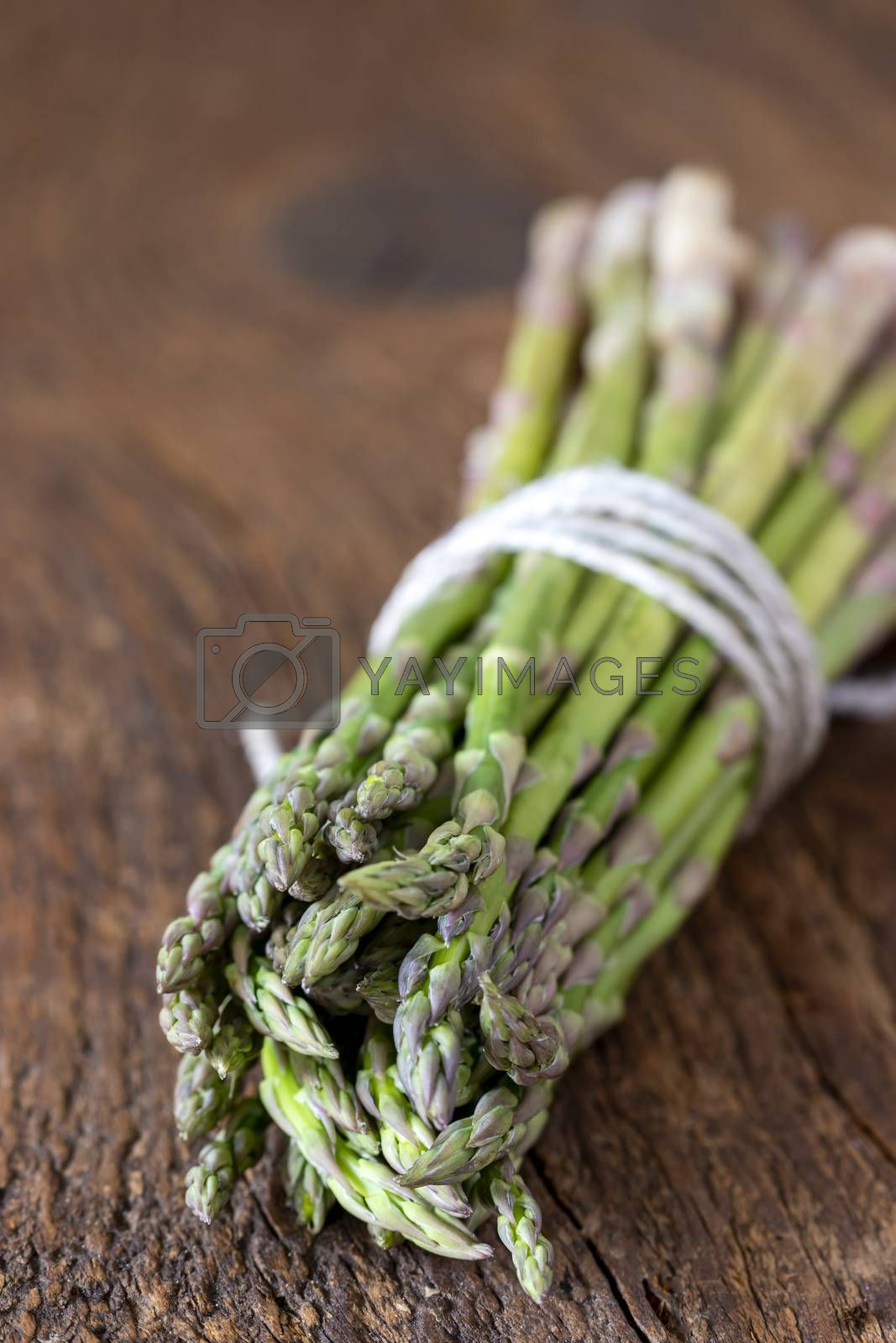wild green asparagus on wood