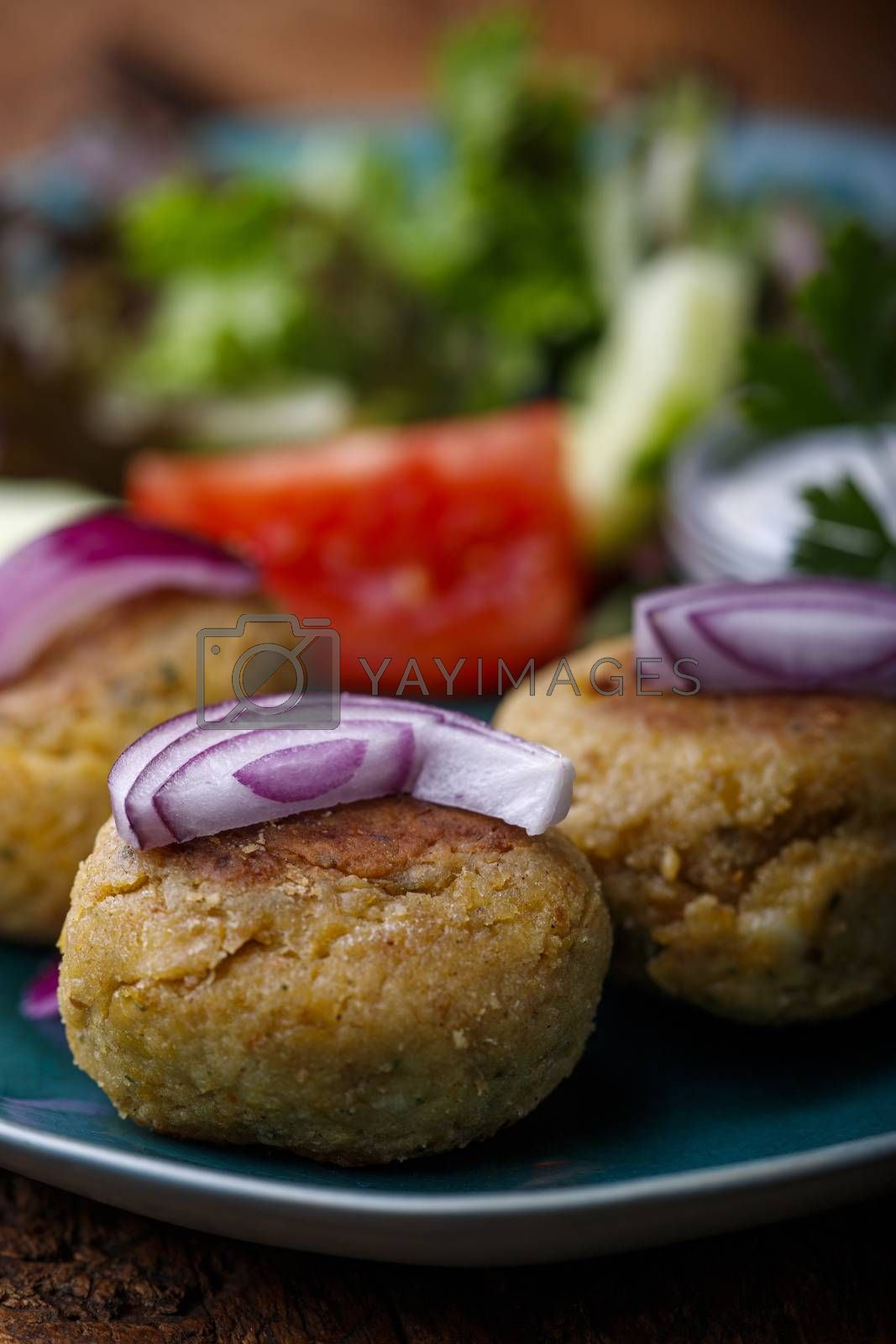 closeup of falafel with onions